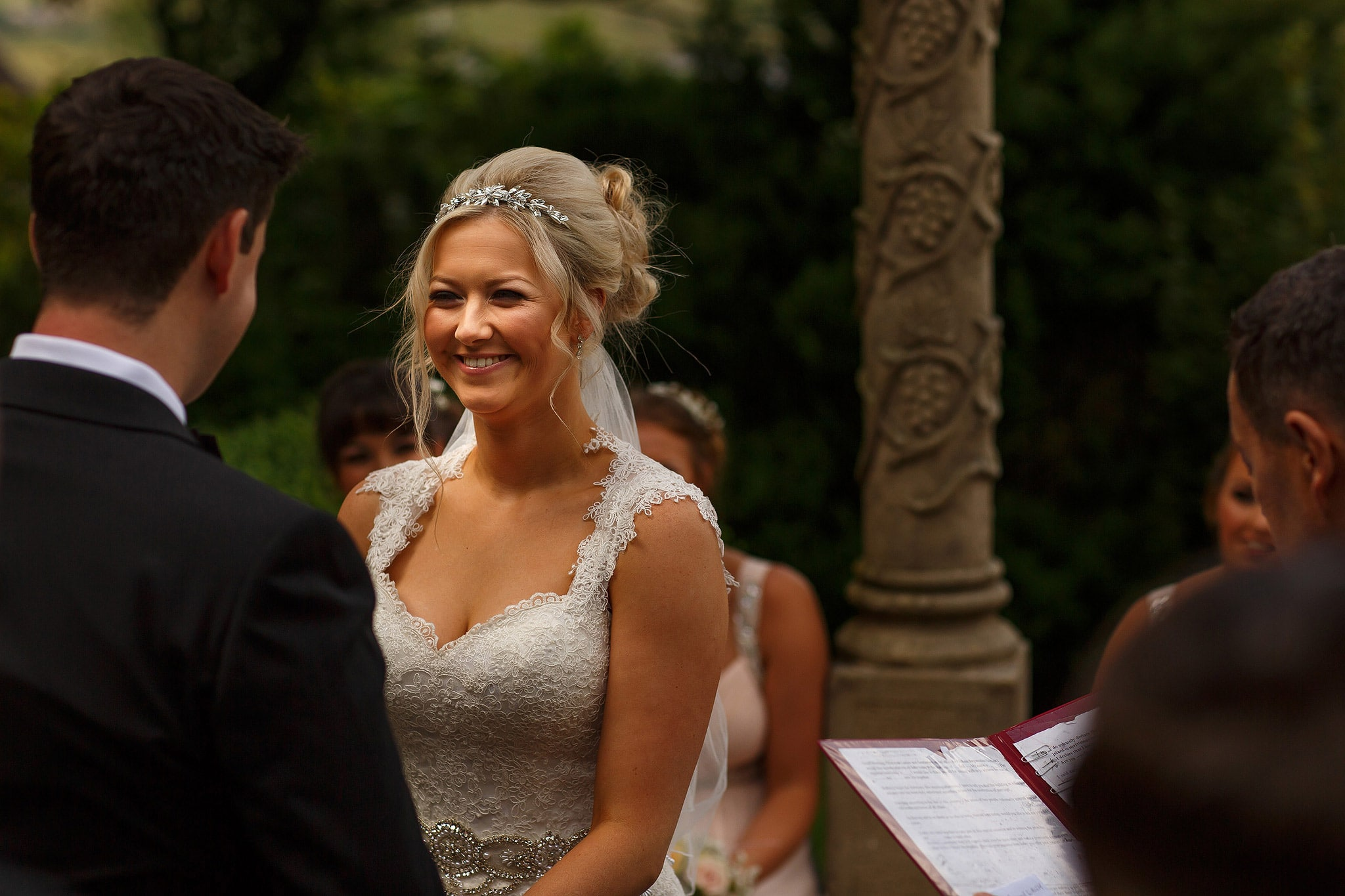 Bride and groom saying vows during outdoor wedding at the saddleworth hotel