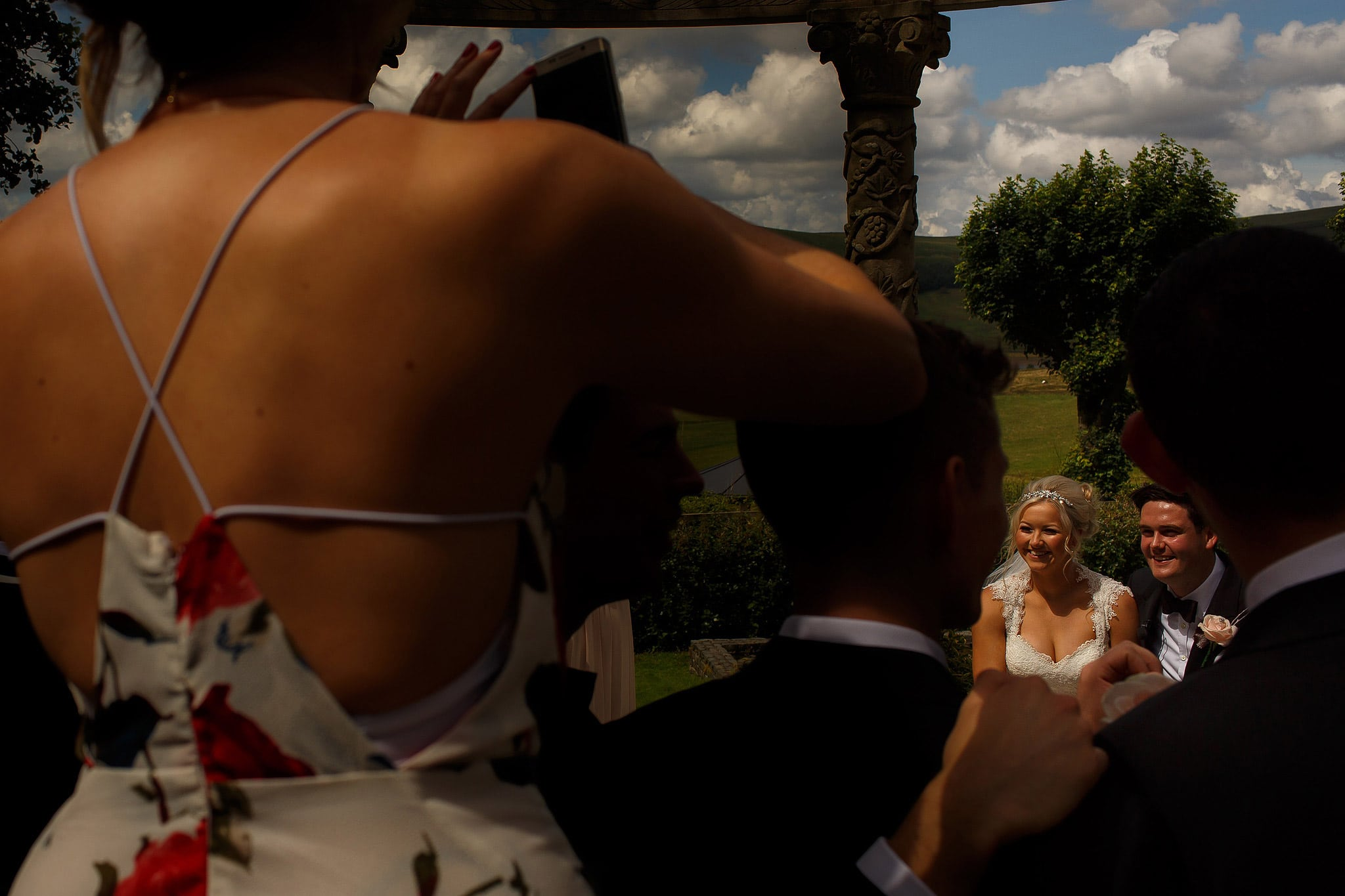 bride and groom signing register during outdoor wedding at Saddleworth Hotel