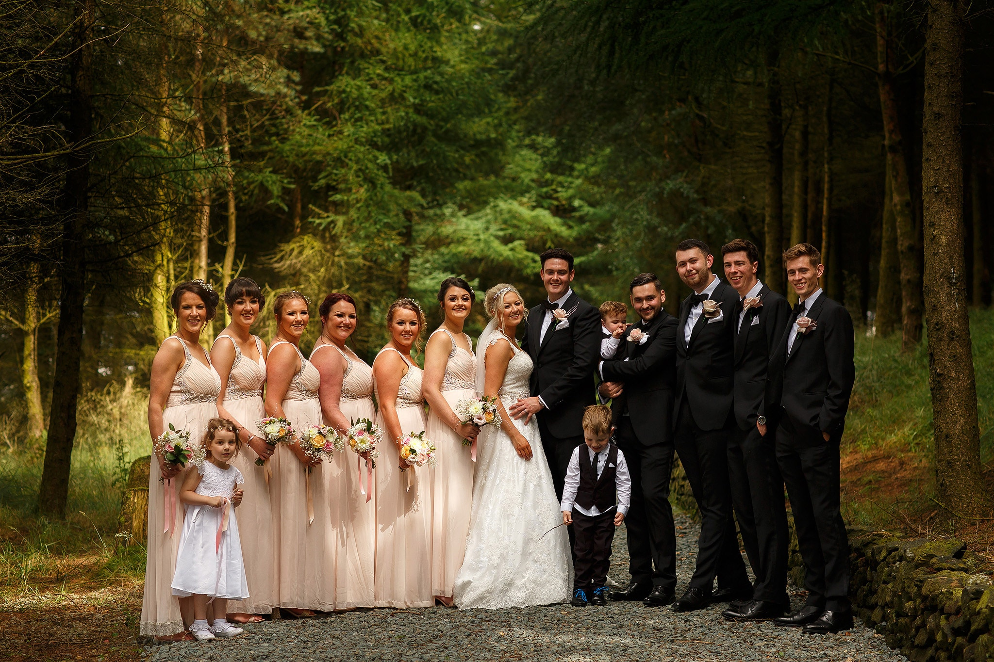 bridal party portrait in the forest behind saddleworth hotel