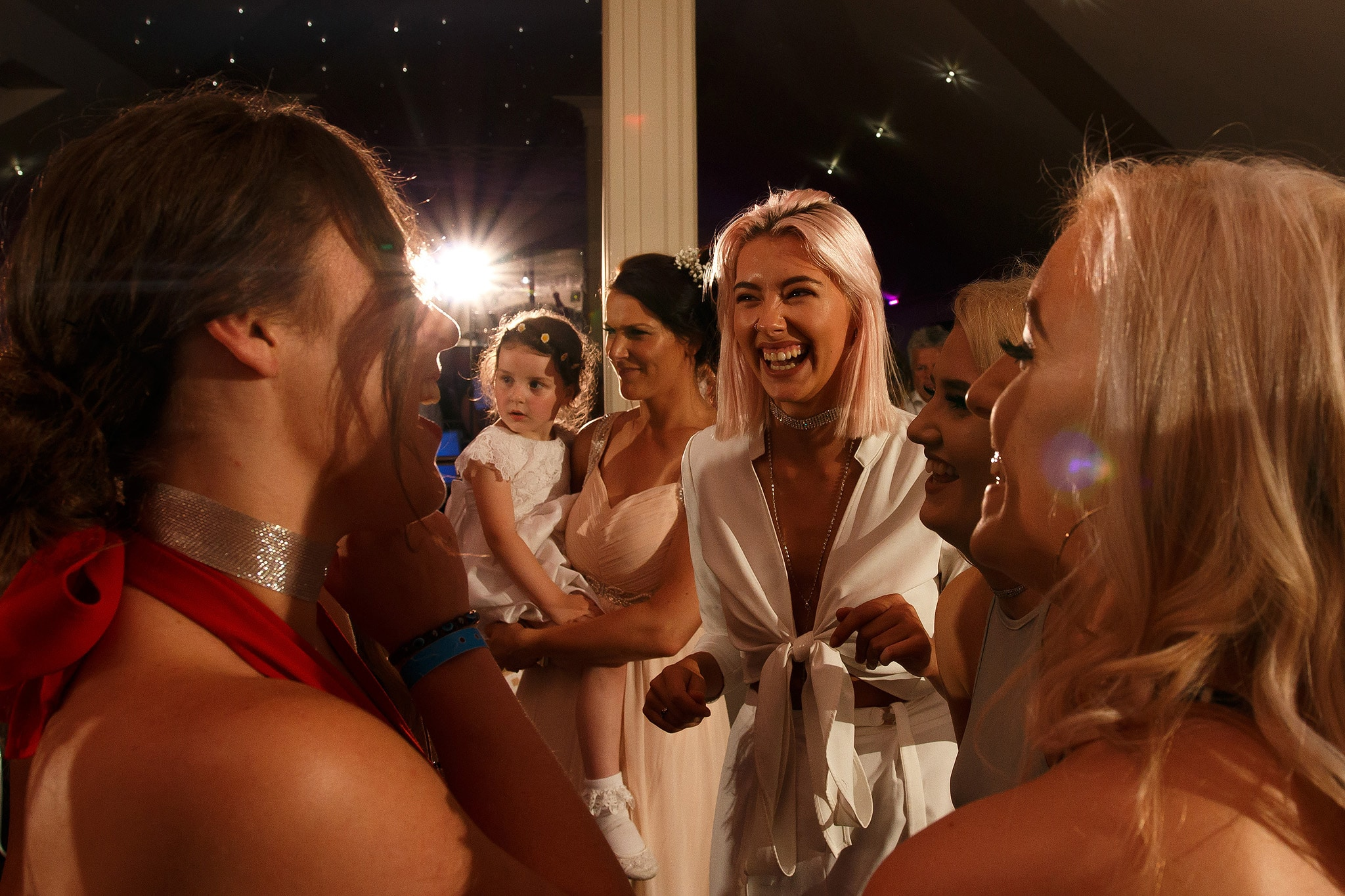 girls laughing on the dance floor at saddleworth hotel wedding reception