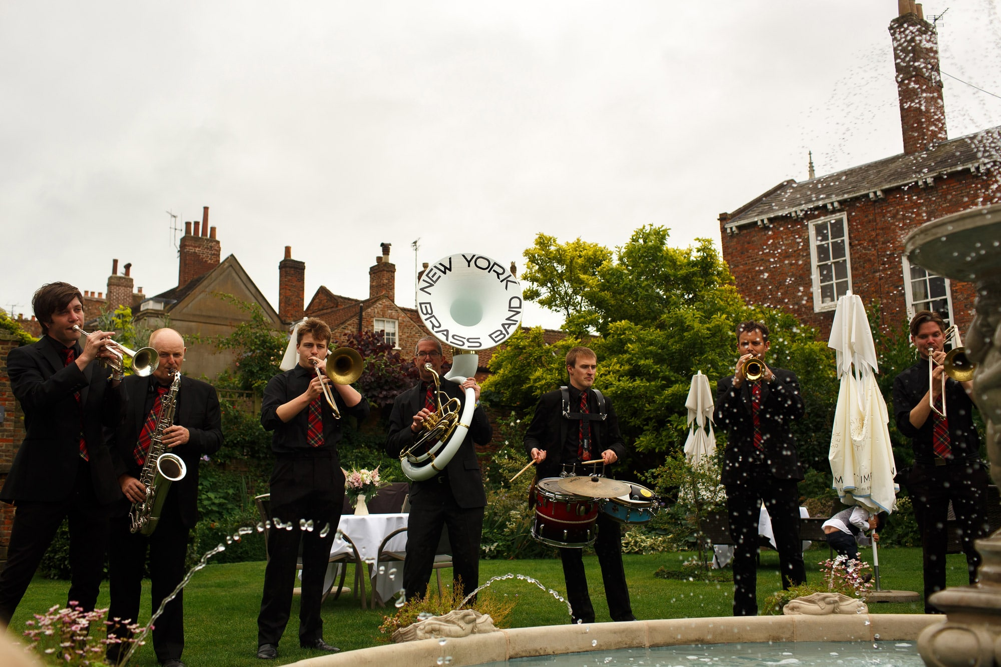 New York Brass Band playing after wedding ceremony in walled garden at grays court wedding