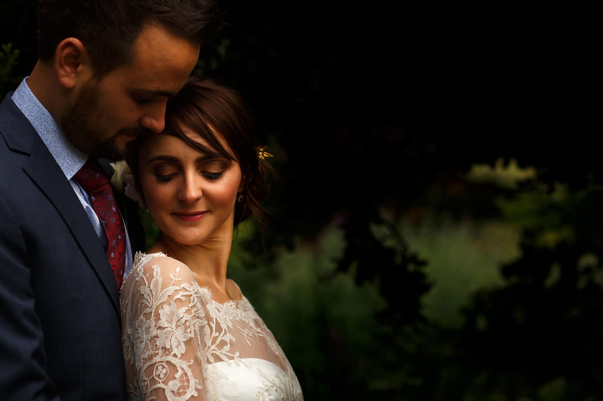 Close up portrait of bride and groom on their wedding day in the walled gardens at grays court wedding