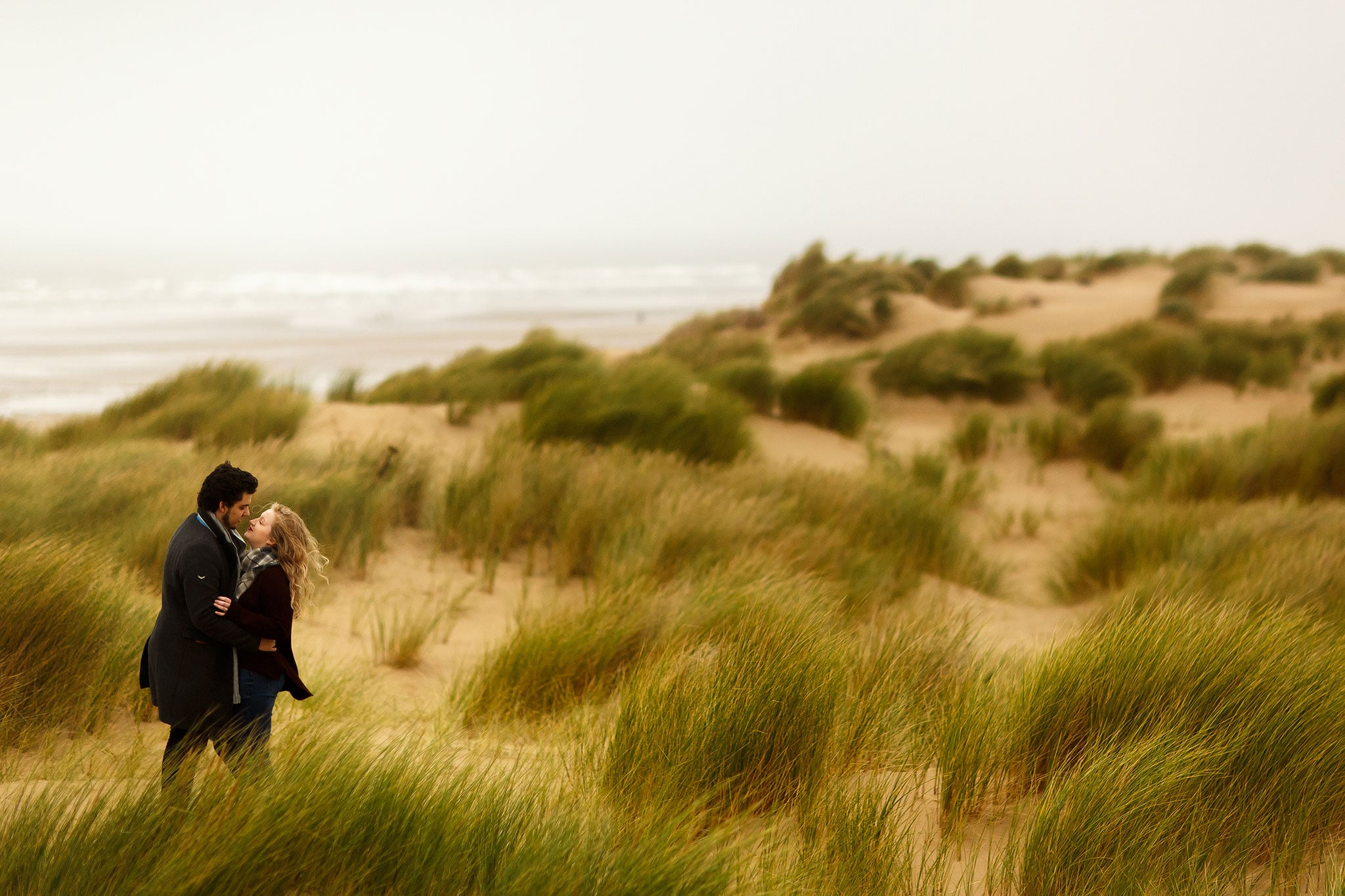 Autumn engagement shoot on the beach in the sand dunes.