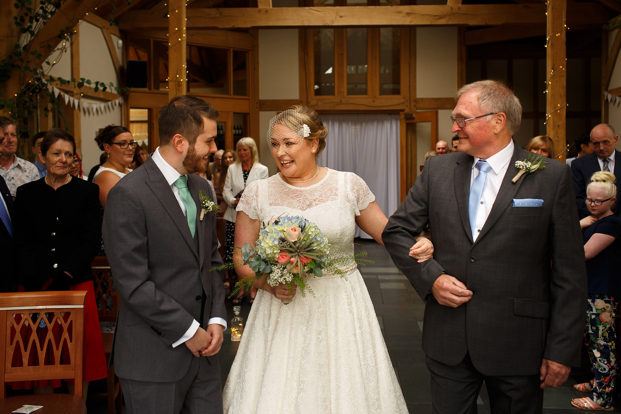 Bride with blonde hair and bird cage veil on wedding day at the Oak Tree at Peover