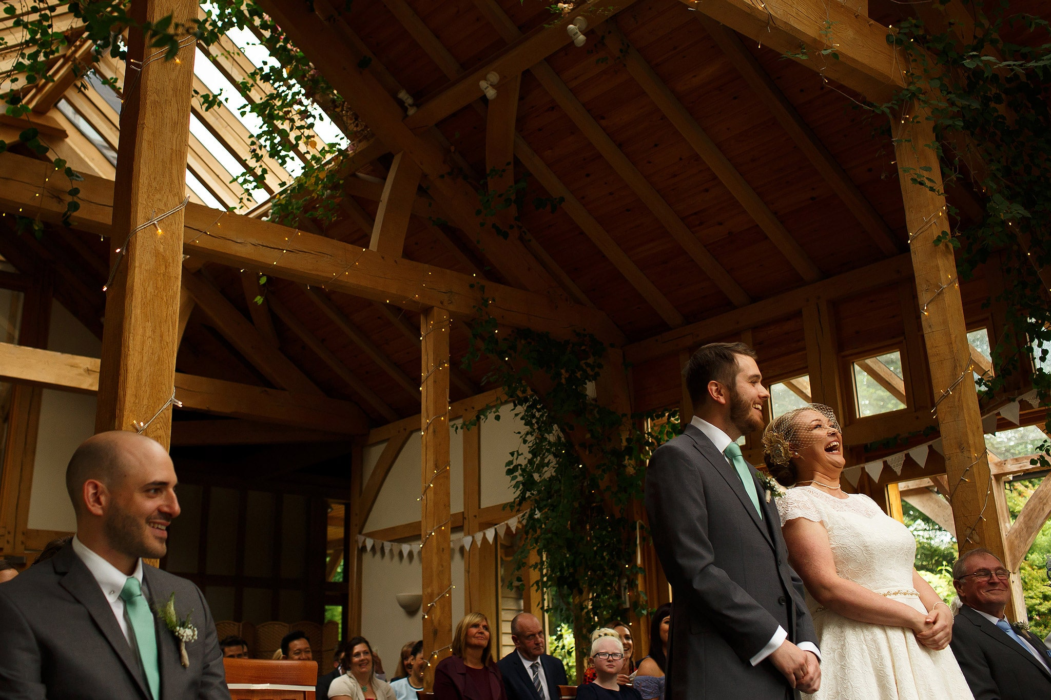 Bride and groom laughing during wedding ceremony at the Oak Tree at Peover