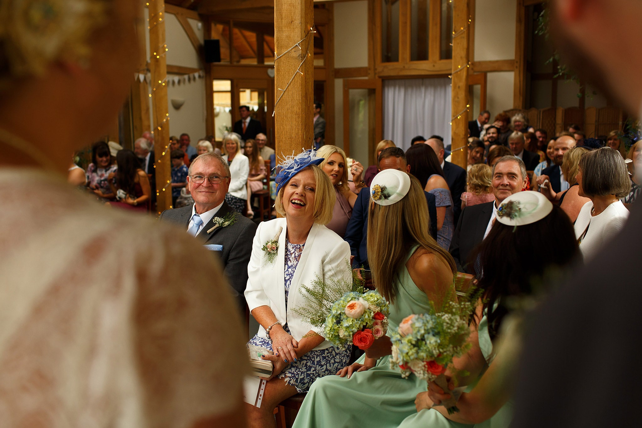 Wedding guests laughing during Oak Tree at Peover civil ceremony