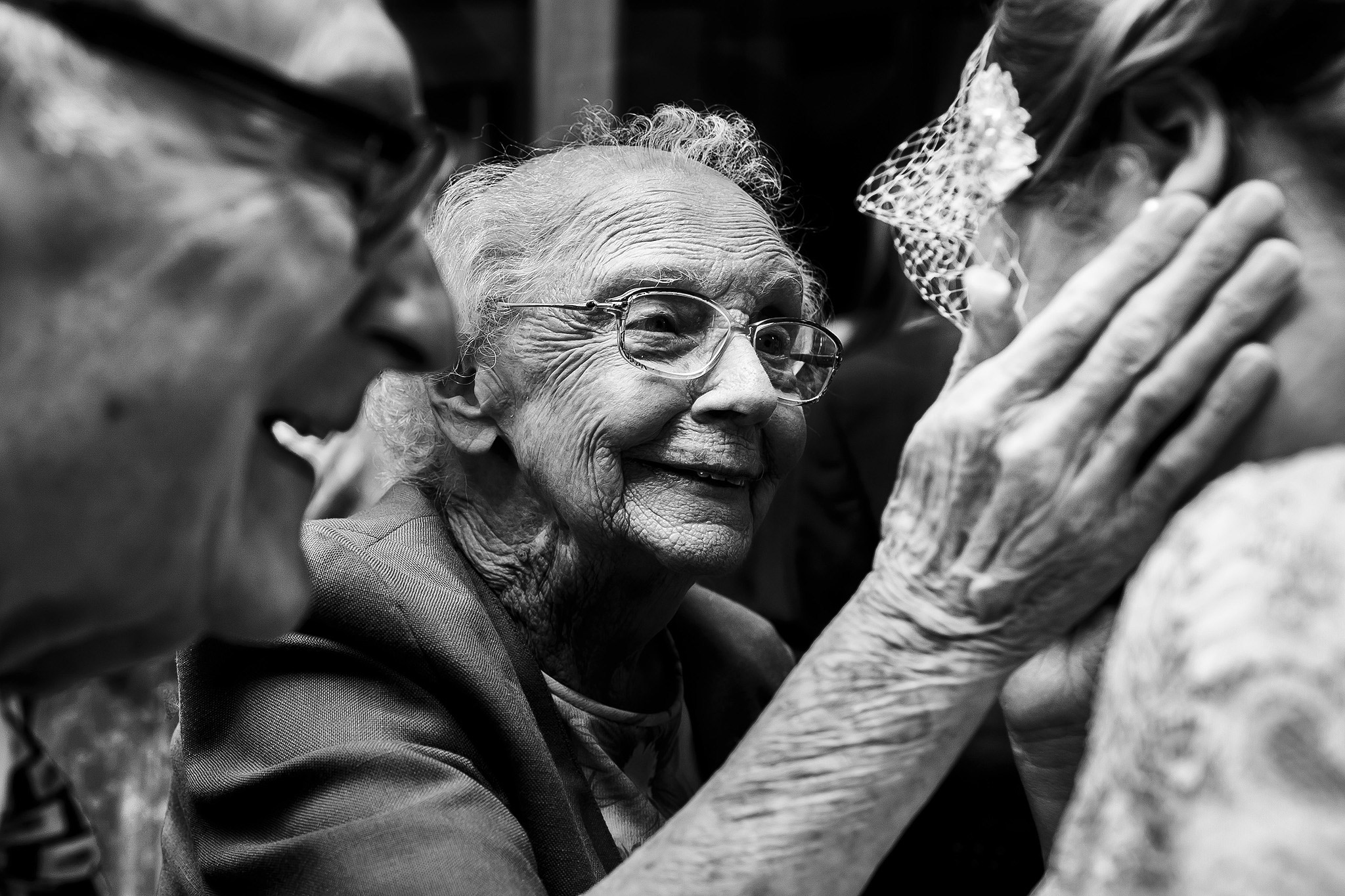 Award winning photograph of elderly relatives congratulating bride on wedding day