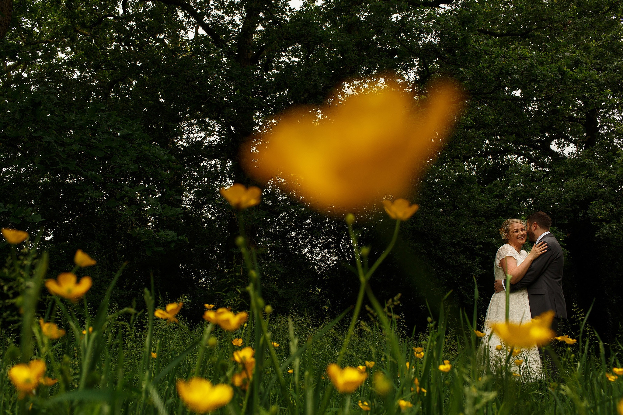 Bride and groom portraits in the countryside at the Oak Tree at Peover wedding
