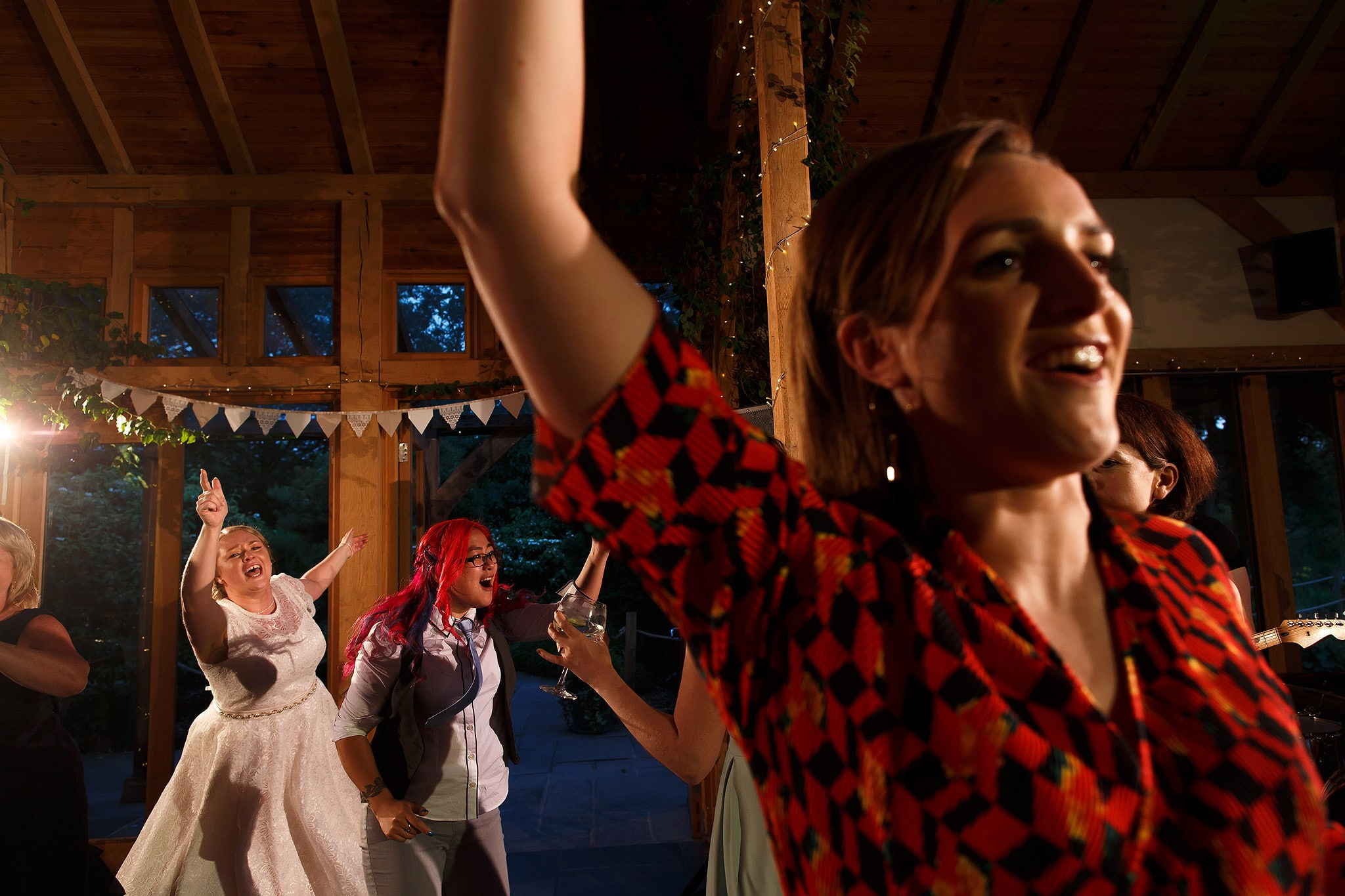 Wedding guests dancing during wedding reception at the Oak Tree at Peover