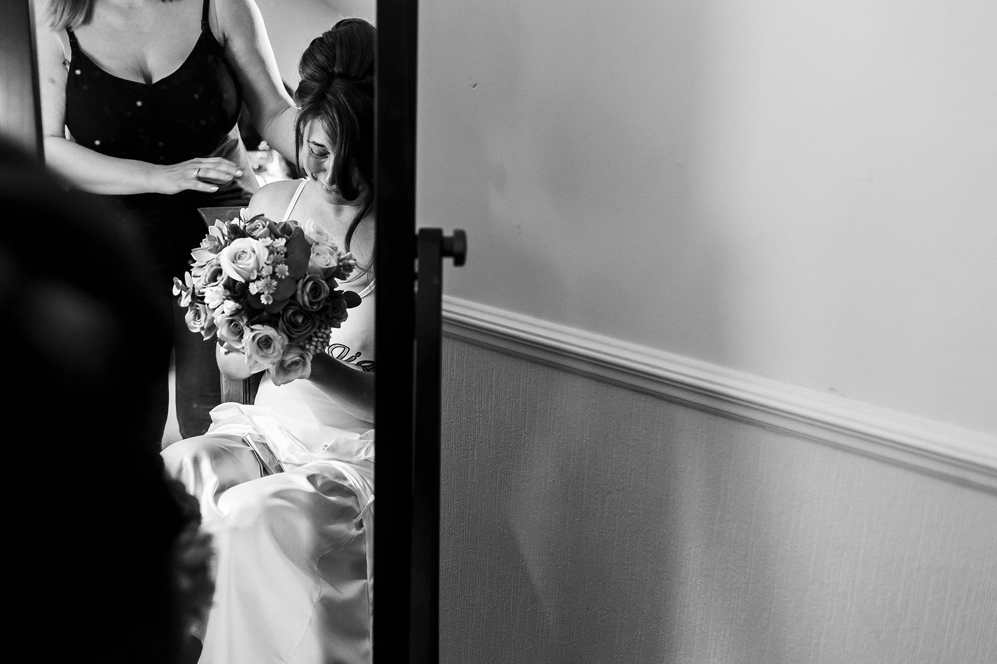 Bride looking into her wedding bouquet.