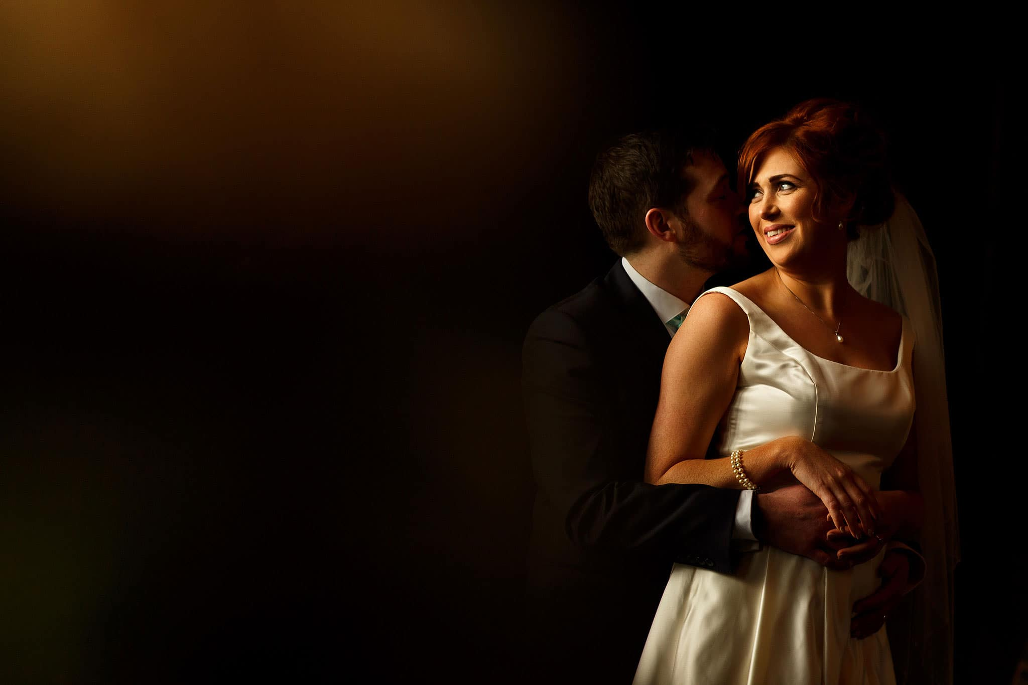 Bride with red hair and groom wedding portraits taken inside the Great Hall at Oakwell Hall