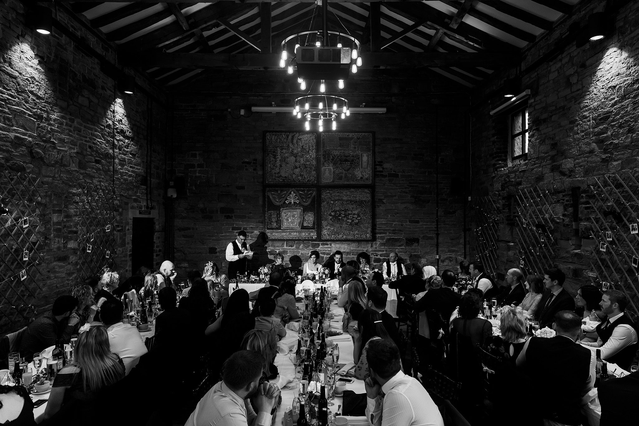 Oakwell Hall Barn wedding speeches with banqueting layout of tables