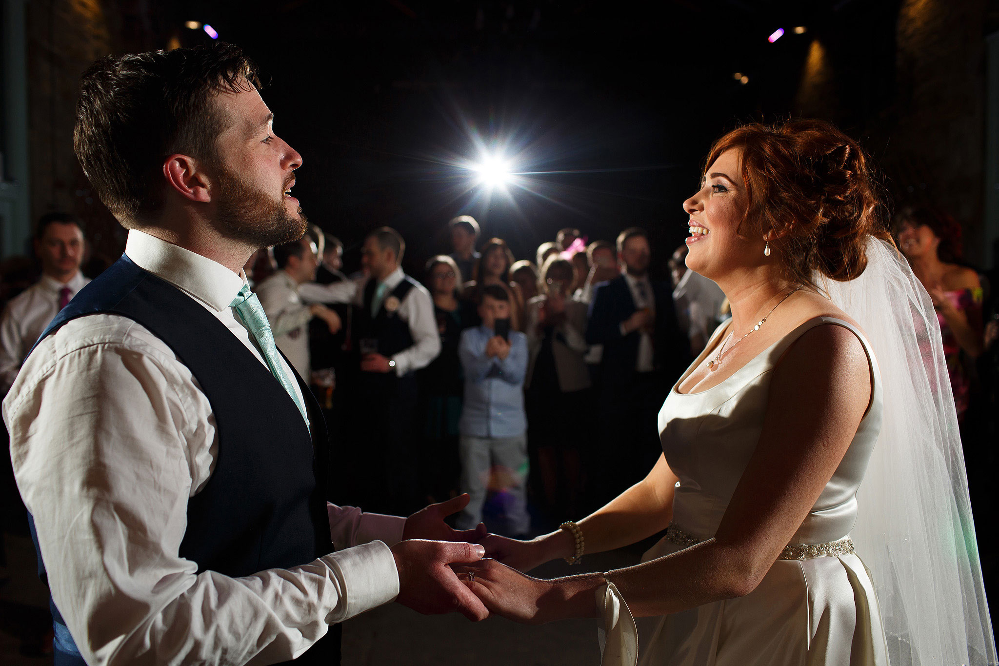Bride and groom's first dance during Oakwell Hall Barn wedding reception