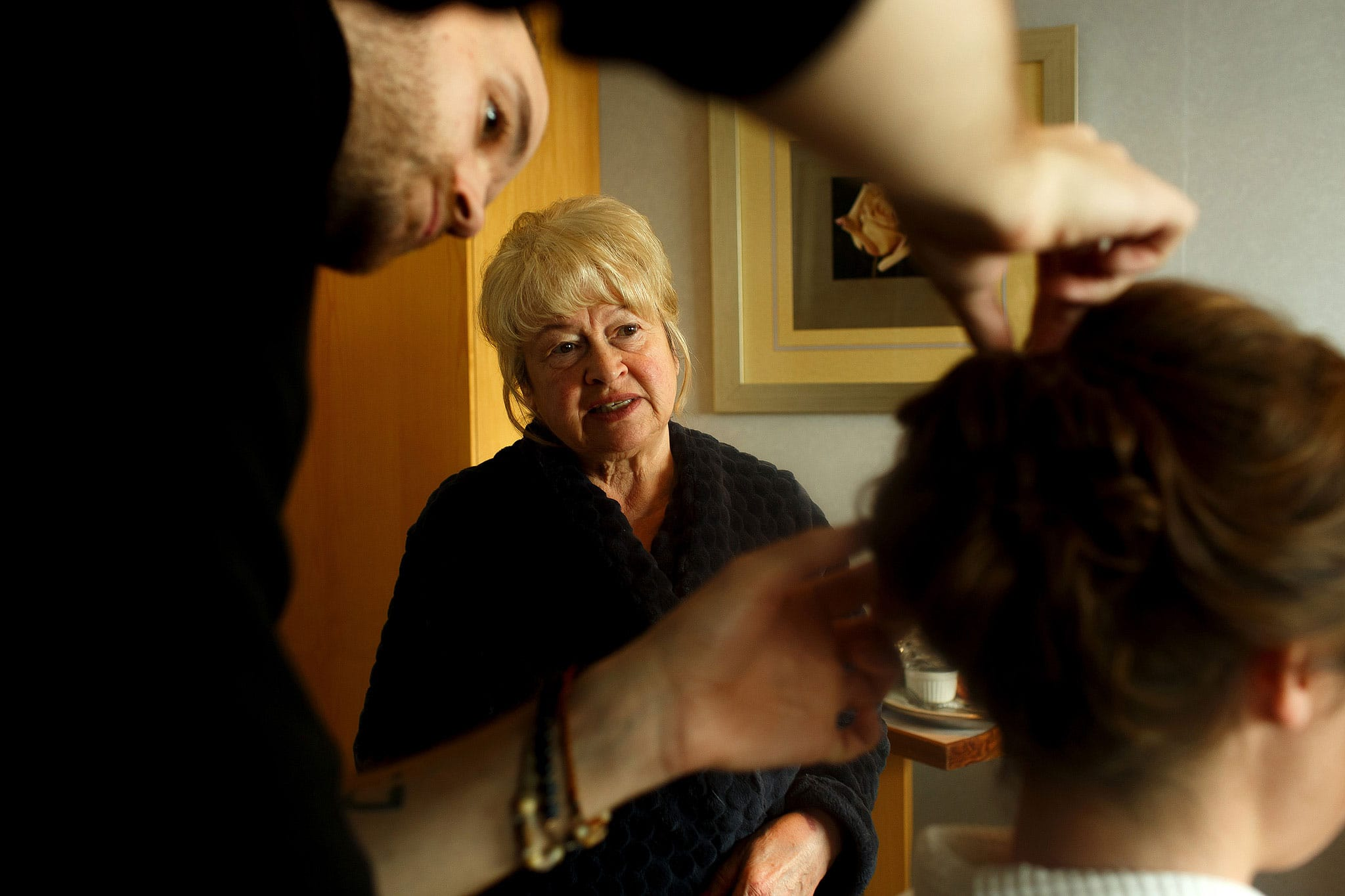 Mother of the bride watching the bride have make up applied on the morning of her wedding day at Rivington Hall Barn