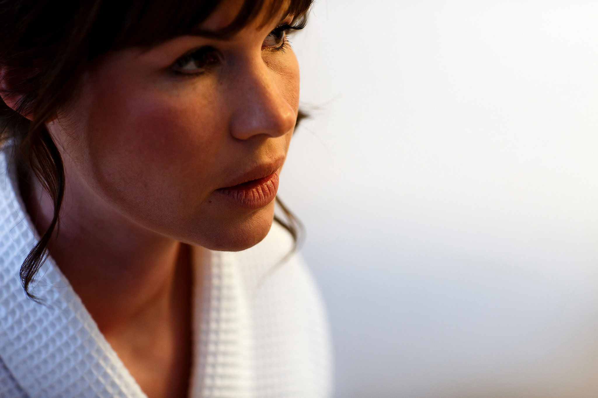 Close up portrait of bride with full fringe and brunette hair on the morning of her wedding day