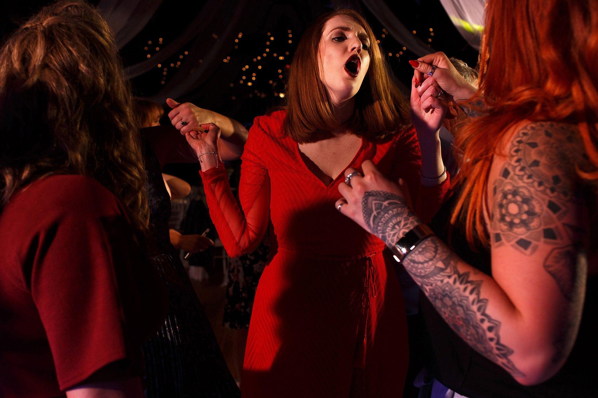 Wedding guests dancing during Rivington Hall barn wedding reception