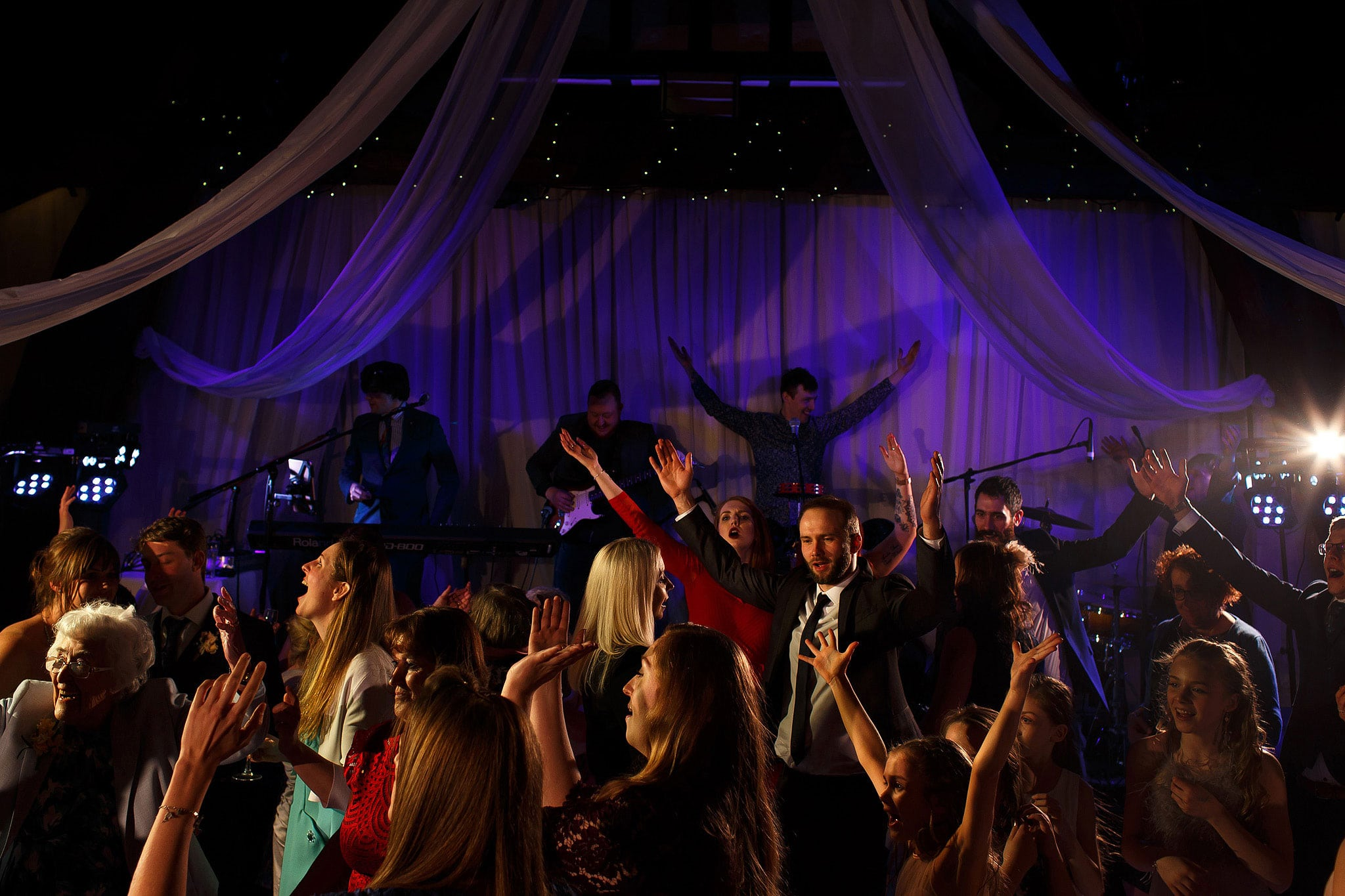Packed dance floor during Rivington Hall Barn wedding reception