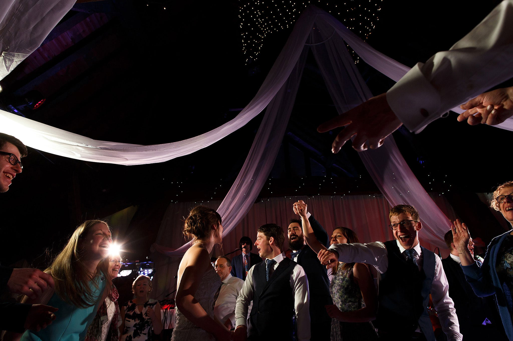 Wedding guests dancing during Rivington Hall barn wedding reception