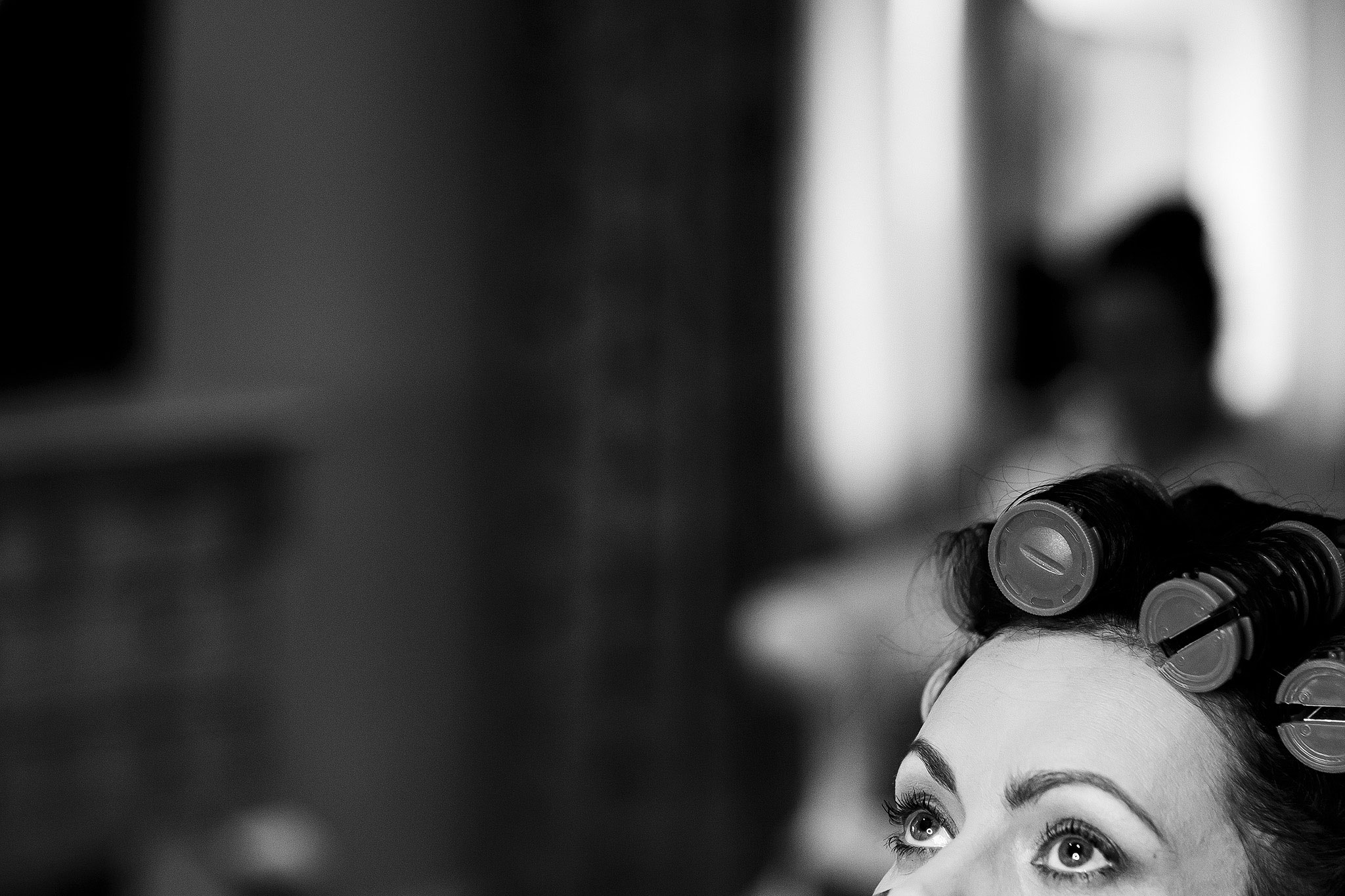 Brides eyes as she looks up while having make up applied in Stanley House Hotel bridal suite