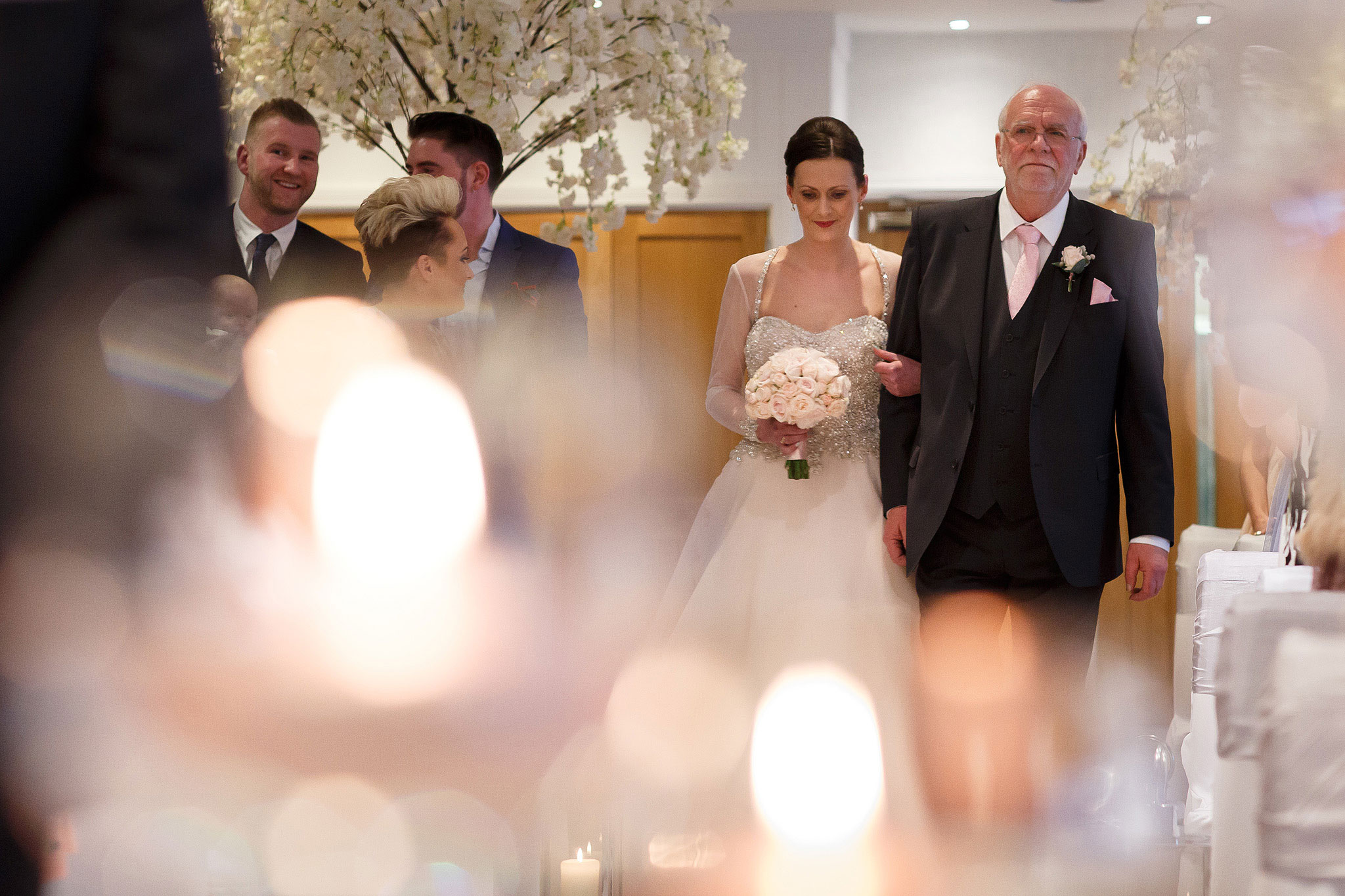 Bride walking down the aisle with her father on her wedding day at Stanley House Hotel