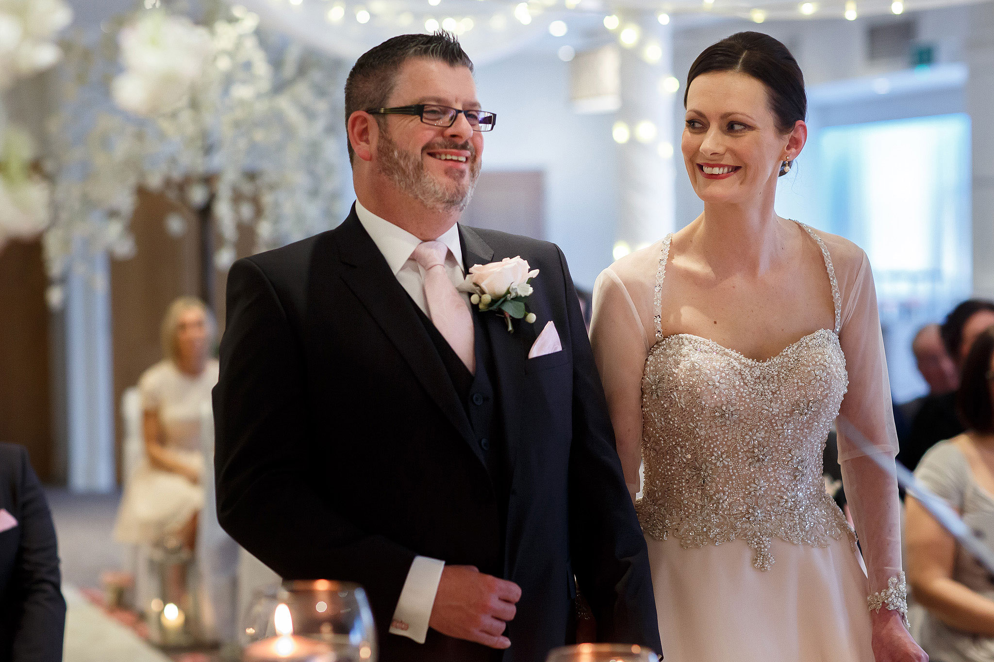 Bride and groom smiling at the top of the aisle during wedding ceremony at Stanley House Hotel