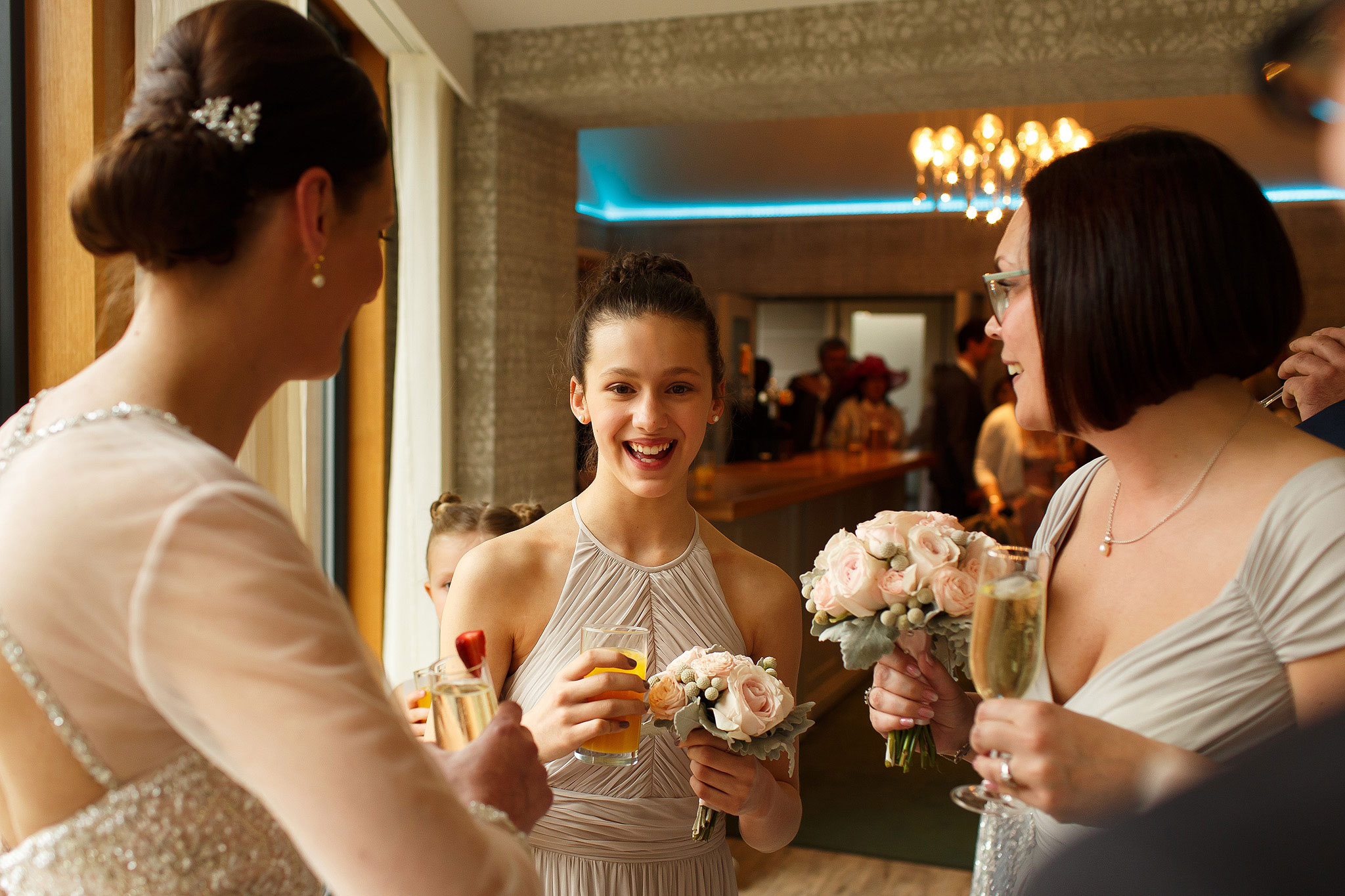 Bride and bridesmaids wearing grey holding pink and grey wedding bouquets during Stanley House Hotel wedding reception