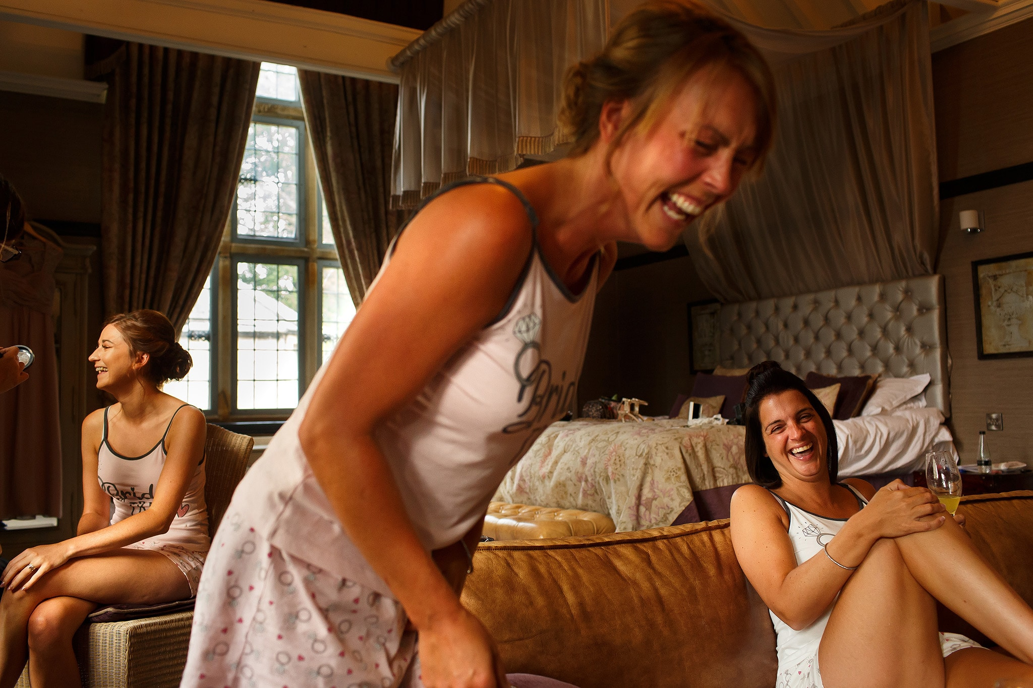bridesmaids wearing matching pyjamas laughing