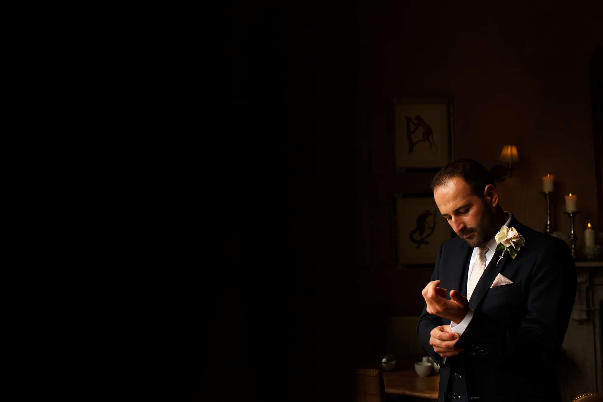 Portrait of Groom wearing navy suit in perfect window light at Falcon Manor wedding