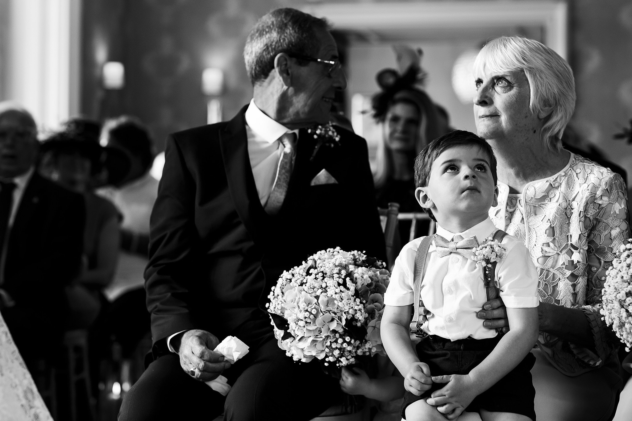 Page boy looking bored during wedding ceremony at Falcon Manor