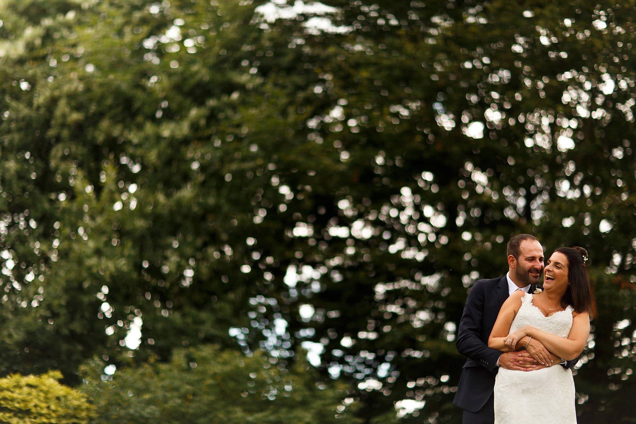 Wedding portrait of bride and groom with amazing bokeh in the gardens at Falcon Manor