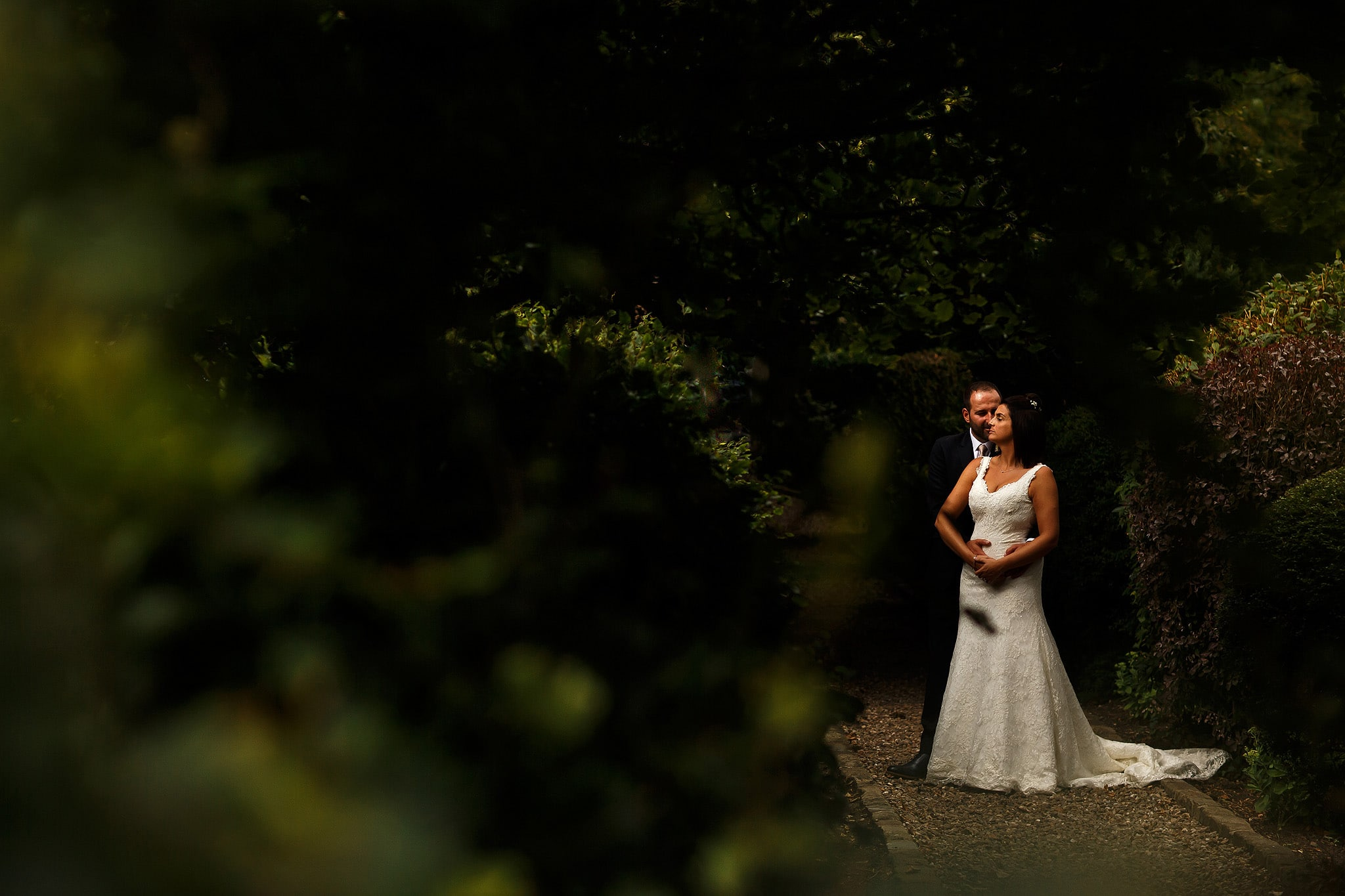 Bride and groom portrait perfectly posed in the gardens at Falcon Manor