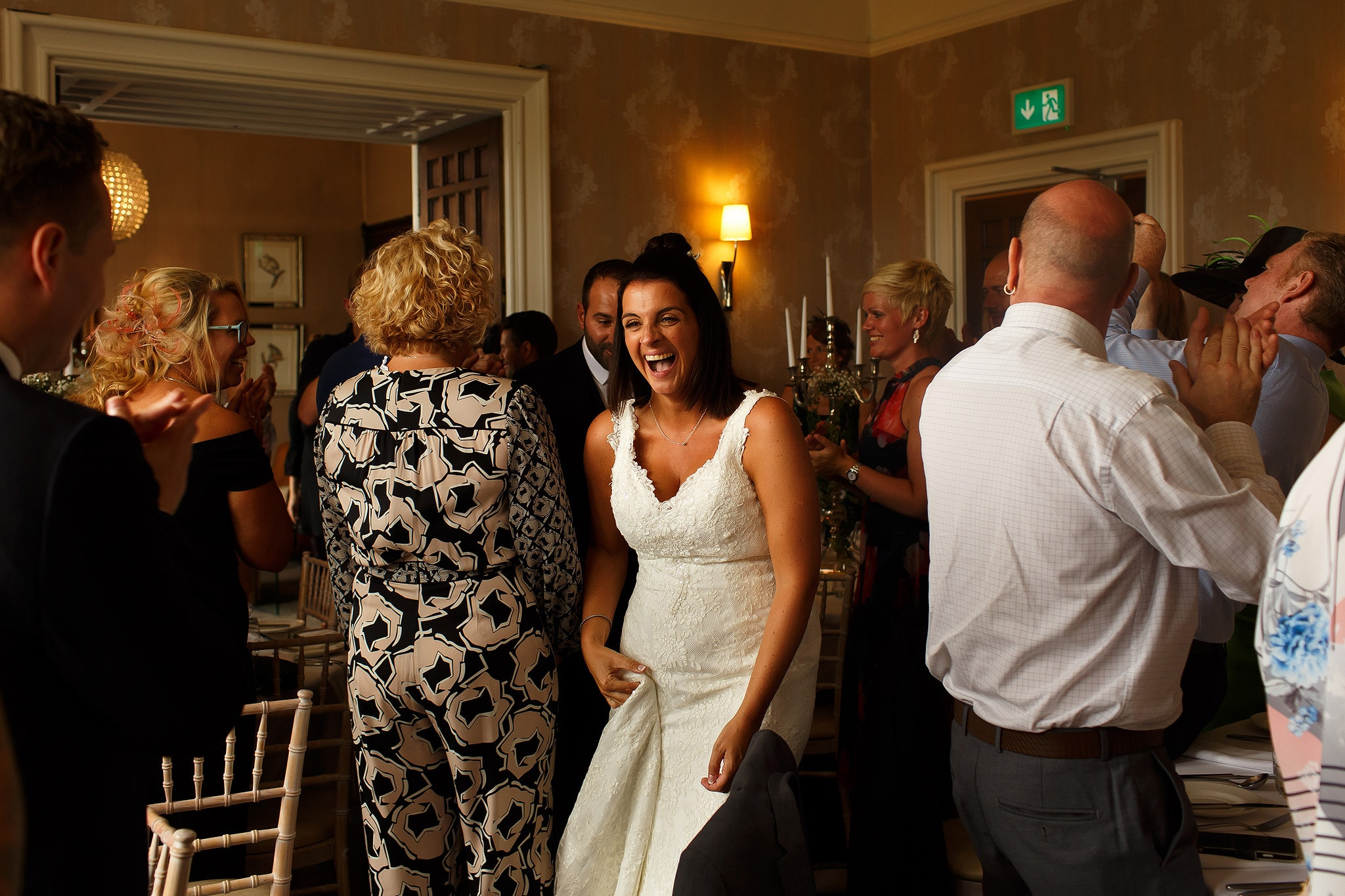 Guests laughing during the wedding reception at Falcon Manor