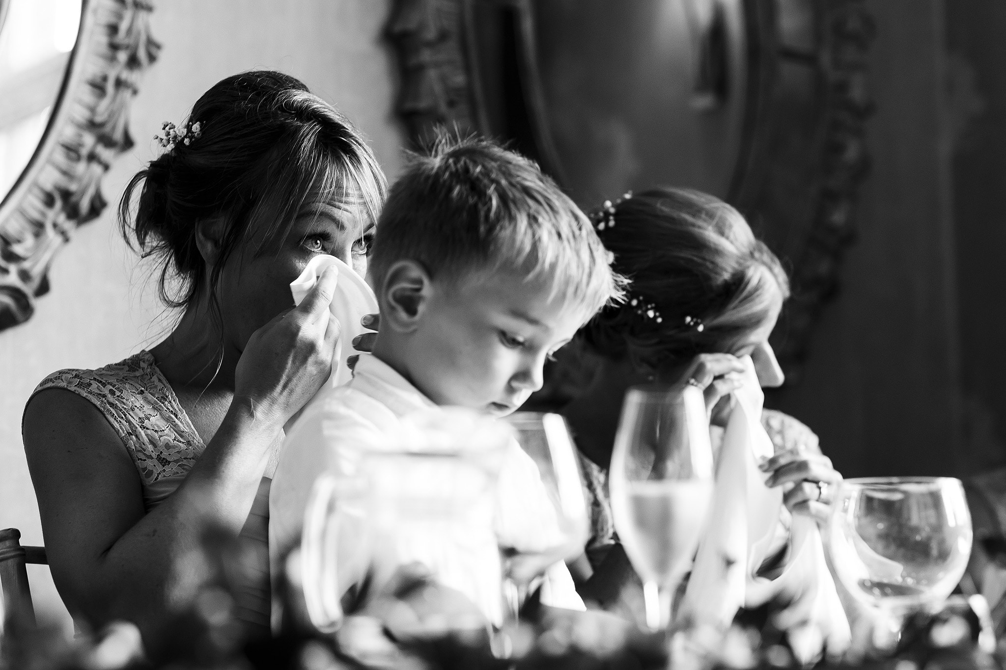 Bridesmaids crying during wedding speeches at Falcon Manor reception