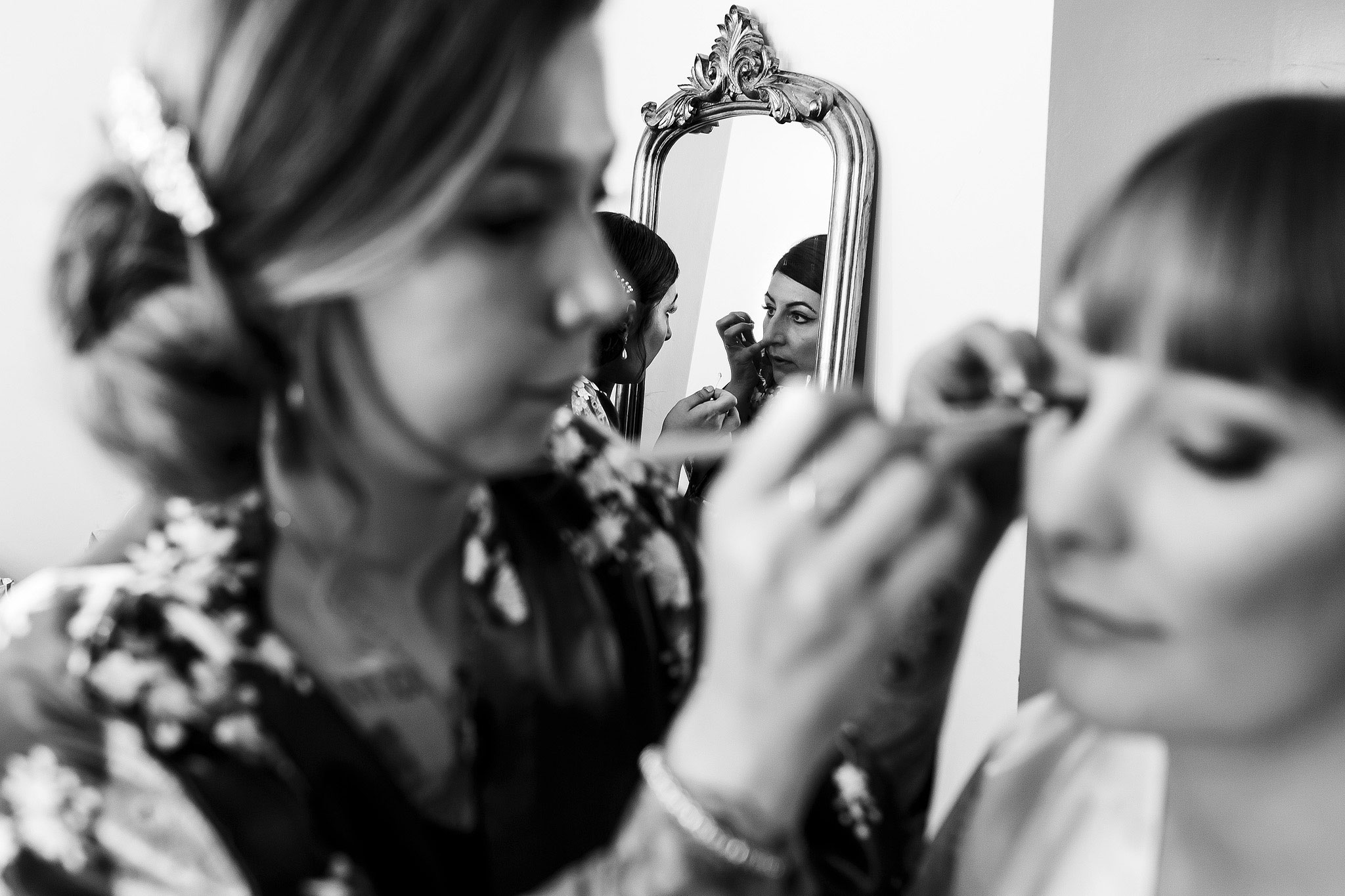 Close up black and white photograph of make up being applied to the bride on the morning of wedding day - The Villa at Wrea Green Wedding Photography - Toni Darcy Photography