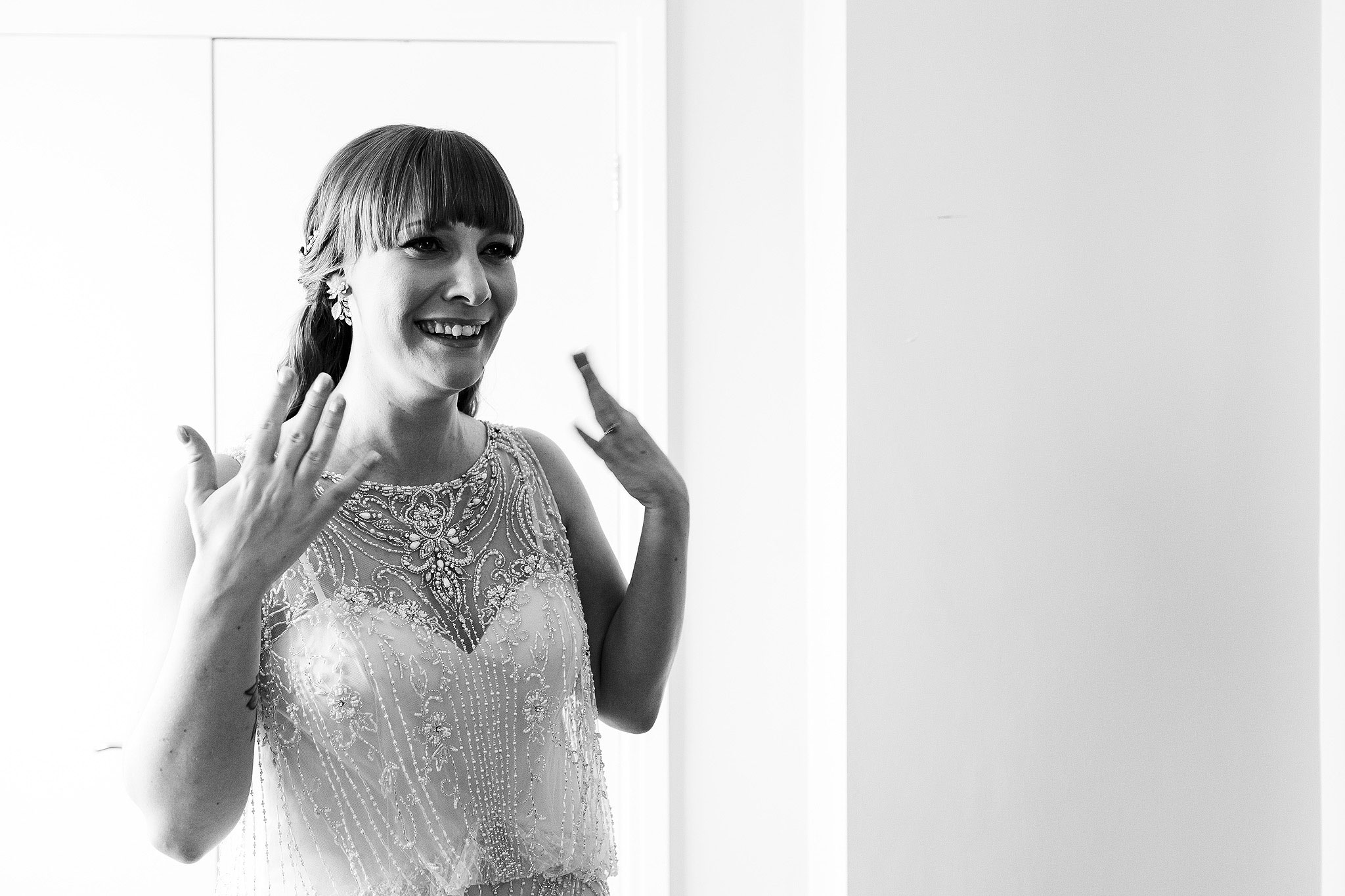 Bride feeling emotional about to cry on the morning of her wedding wearing beaded wedding gown - The Villa at Wrea Green Wedding Photography - Toni Darcy Photography