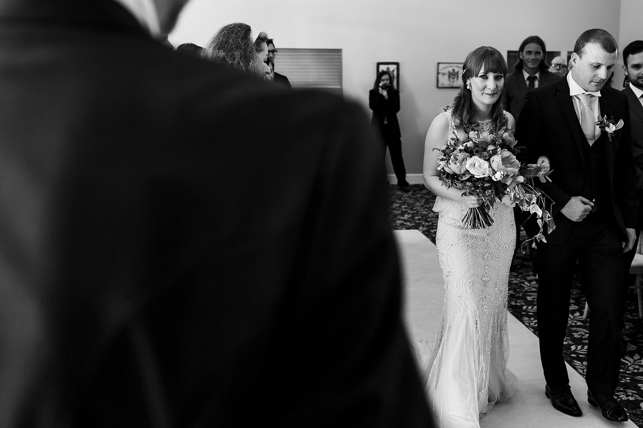 Bride walking down the aisle in beaded wedding dress - The Villa at Wrea Green Wedding Photography - Toni Darcy Photography
