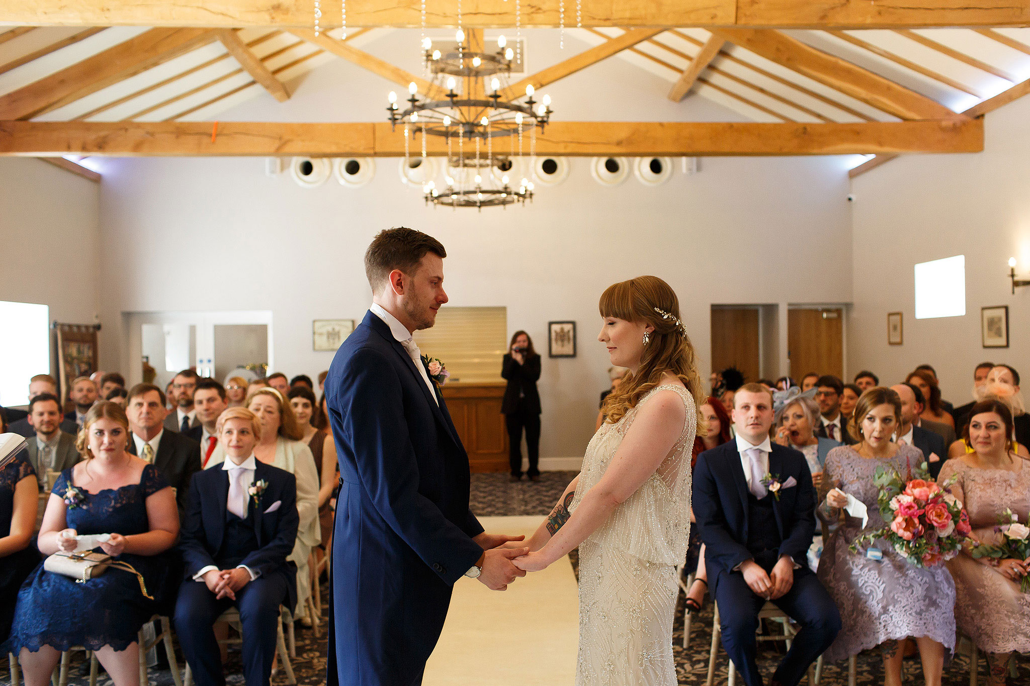 Bride and groom at the top of the aisle holding hands during wedding ceremony - The Villa at Wrea Green Wedding Photography - Toni Darcy Photography