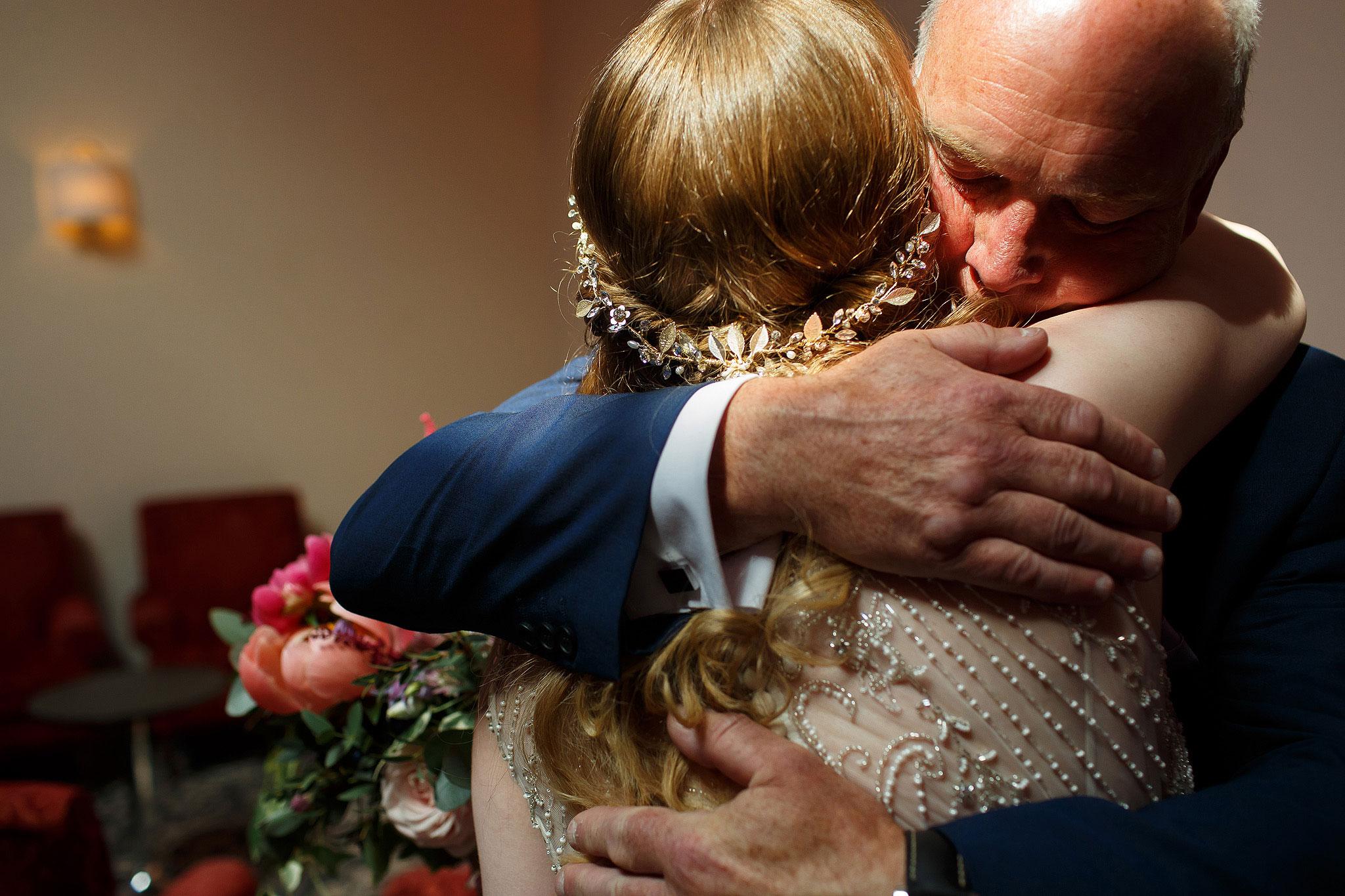 Bride hugging wedding guest - The Villa at Wrea Green Wedding Photography - Toni Darcy Photography