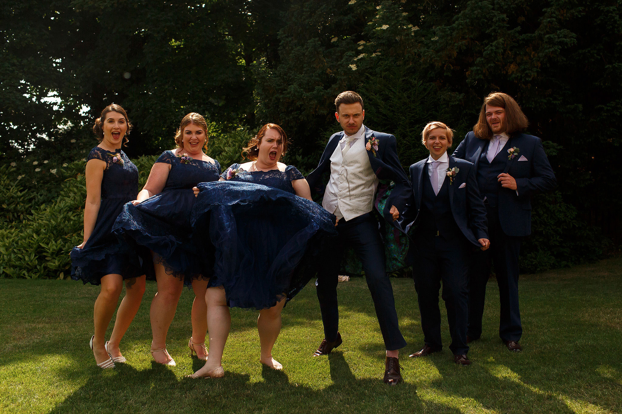 Bridesmaids and groomsmen laughing during bridal party portraits - The Villa at Wrea Green Wedding Photography - Toni Darcy Photography