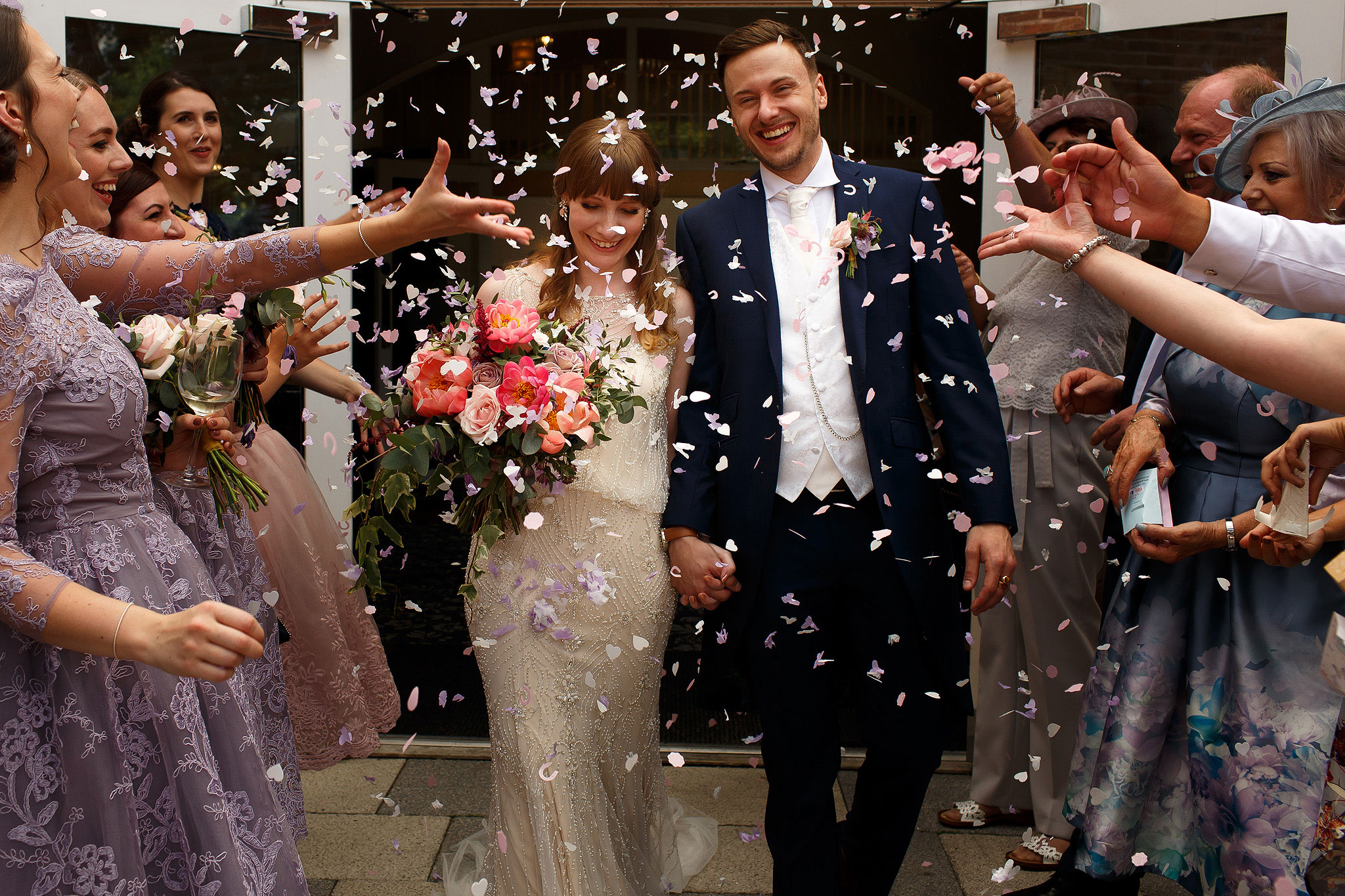 Confetti being thrown outside - The Villa at Wrea Green Wedding Photography - Toni Darcy Photography