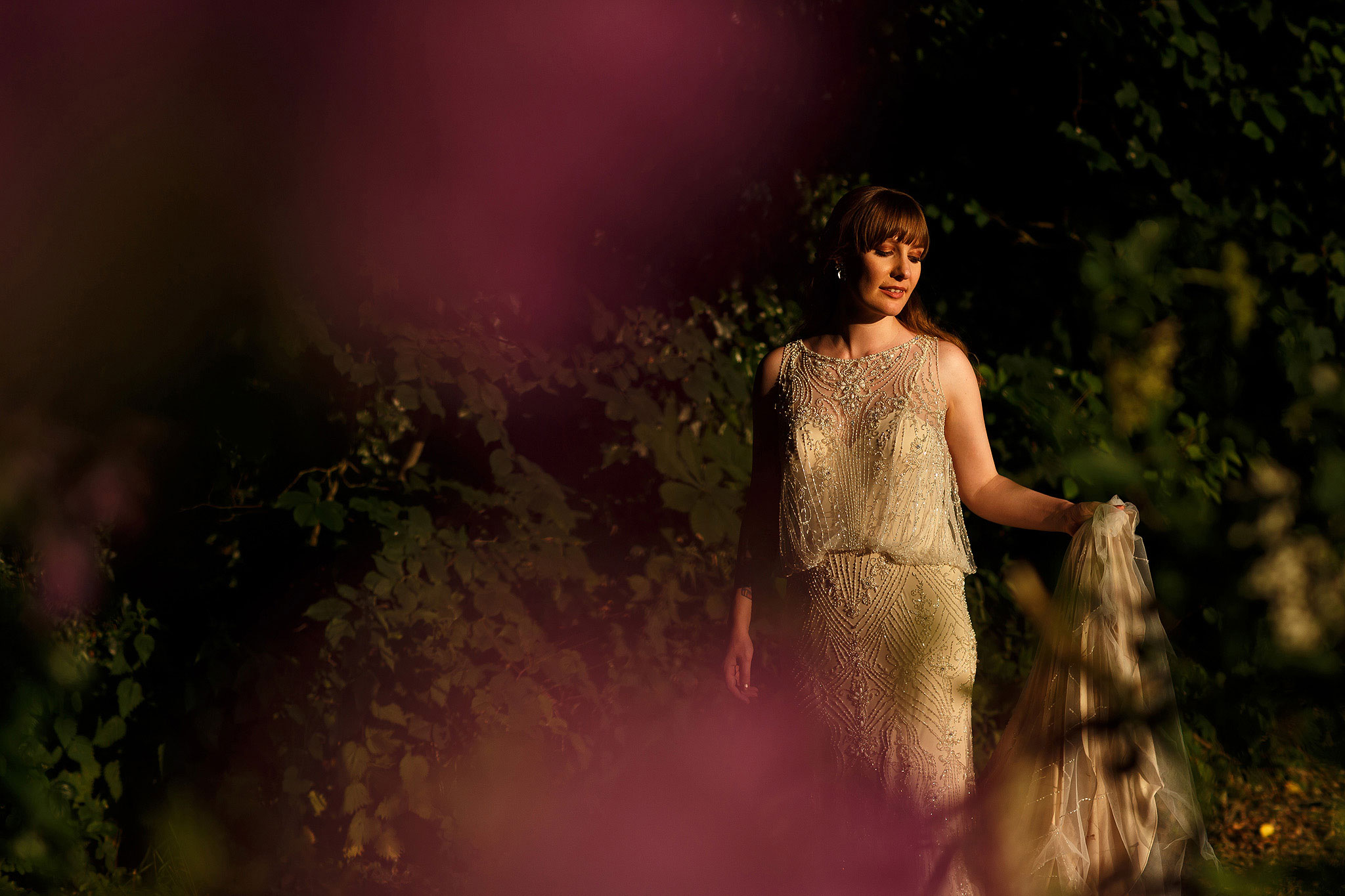 Bride wearing beautiful beaded floor length wedding gown in beautiful sunlight during the wedding day portraits - The Villa at Wrea Green Wedding Photography - Toni Darcy Photography