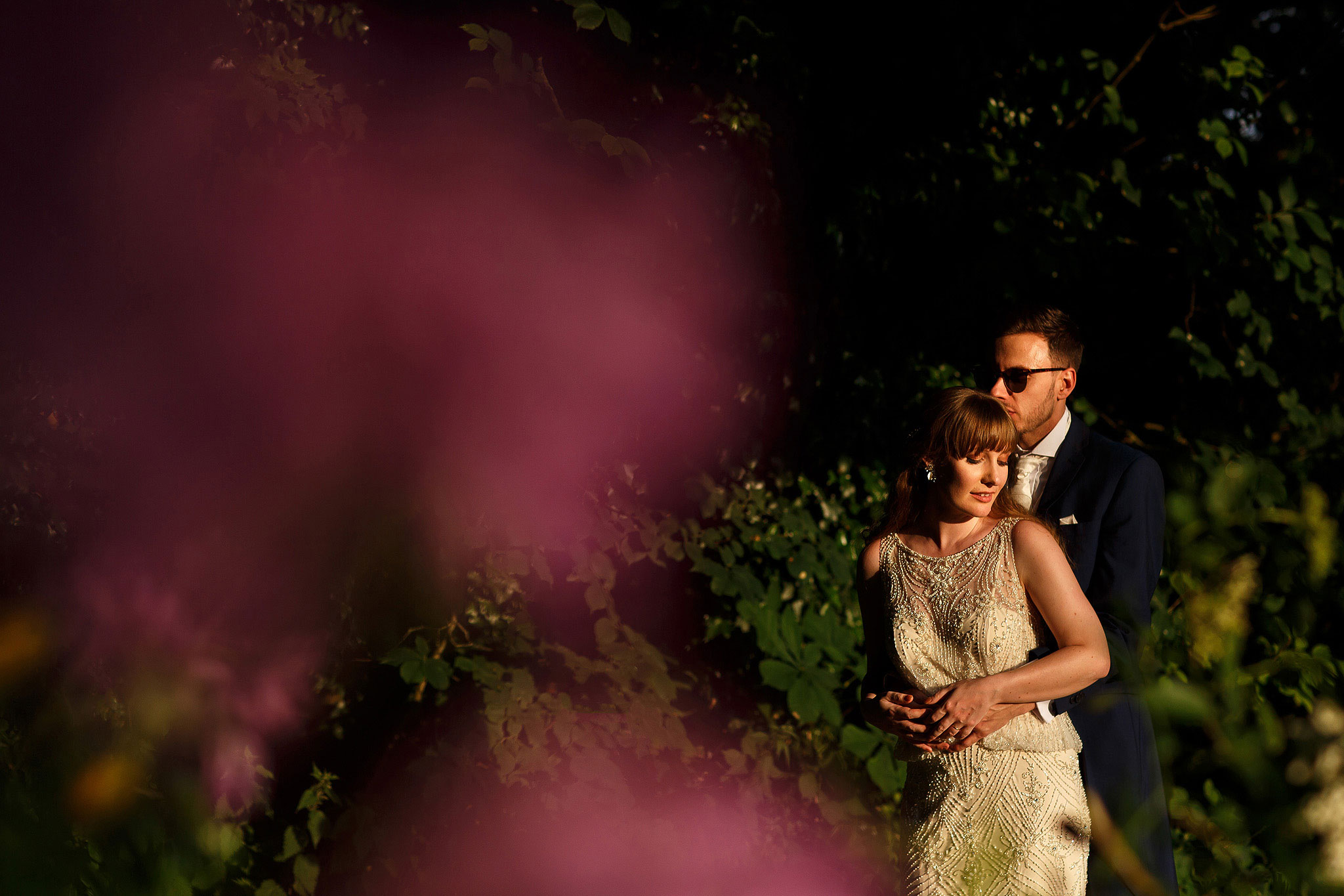 Sexy wedding day portrait of bride and groom in beautiful light in the gardens during wedding day portraits - The Villa at Wrea Green Wedding Photography - Toni Darcy Photography