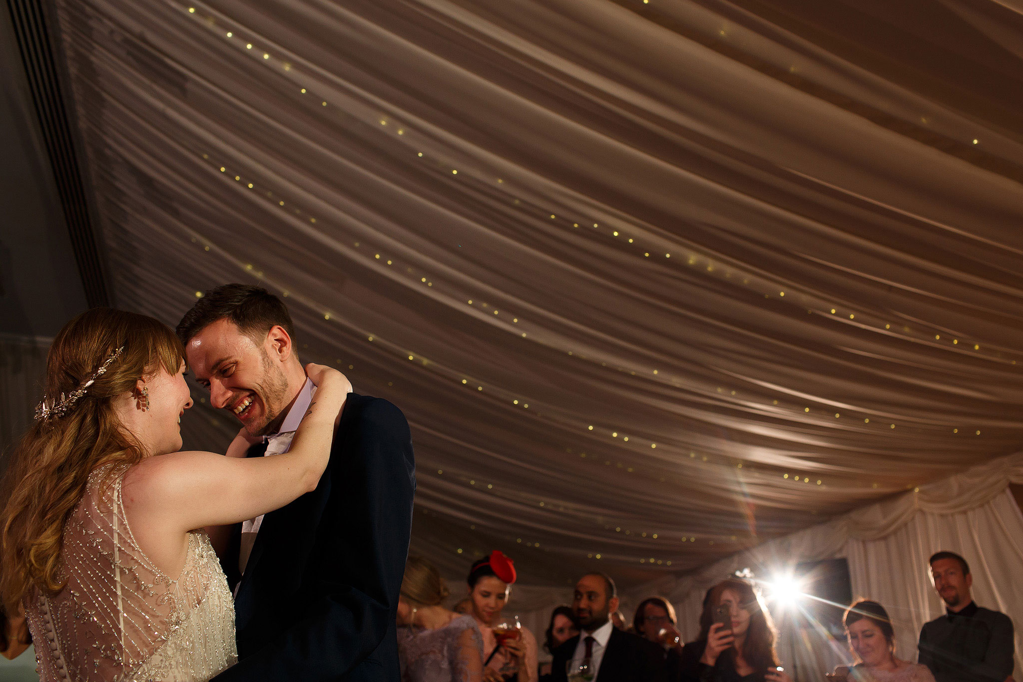 Bride and groom laughing during first dance in the Pavilion - The Villa at Wrea Green Wedding Photography - Toni Darcy Photography