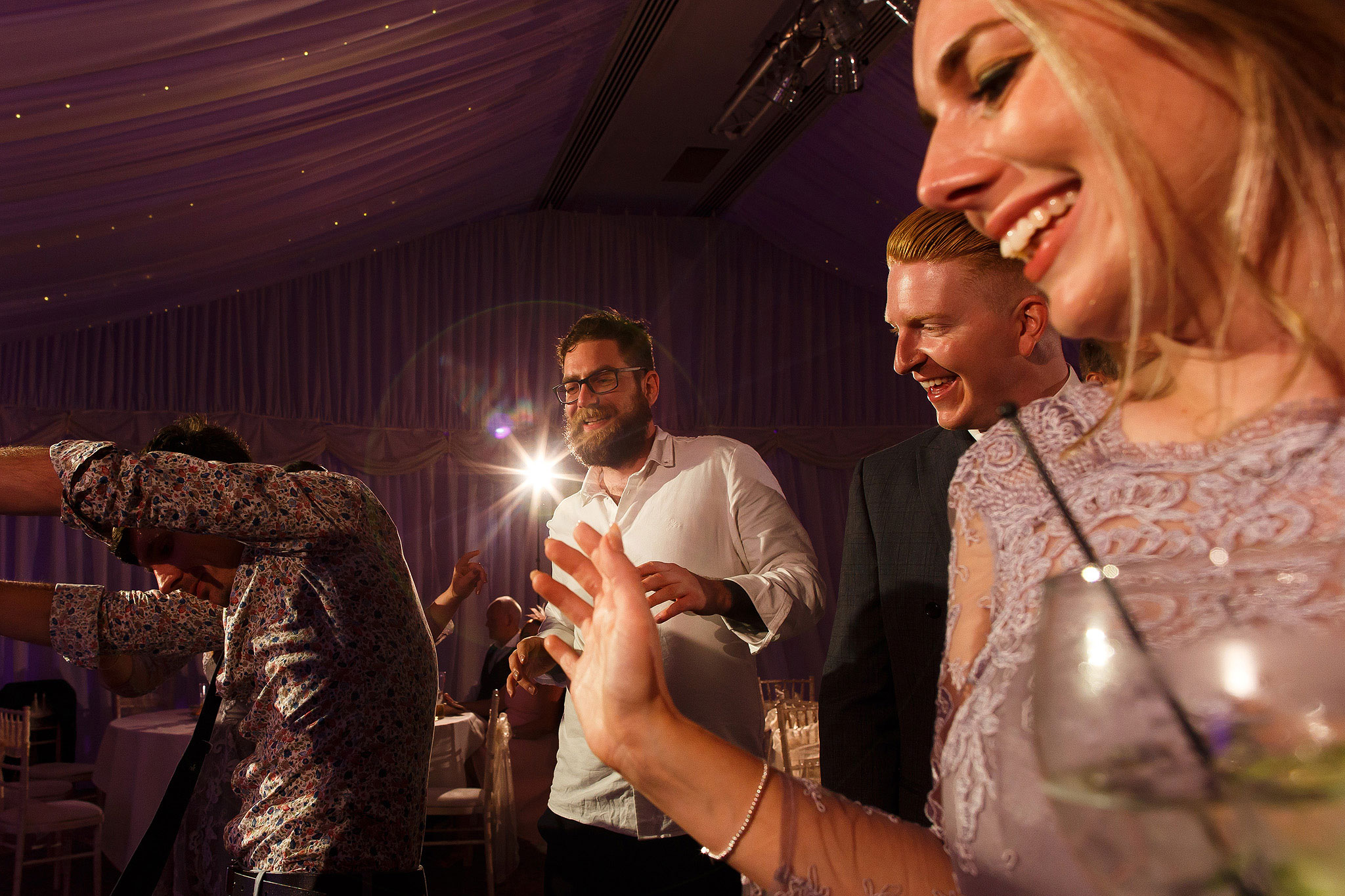 Wedding guests laughing and dancing in the Pavilion - The Villa at Wrea Green Wedding Photography - Toni Darcy Photography
