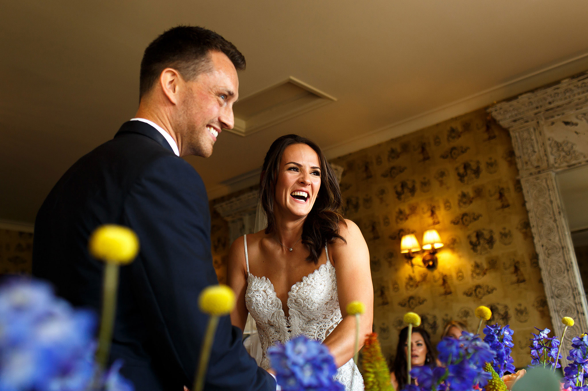 Bride and groom laughing during wedding ceremony at the Shireburn Arms