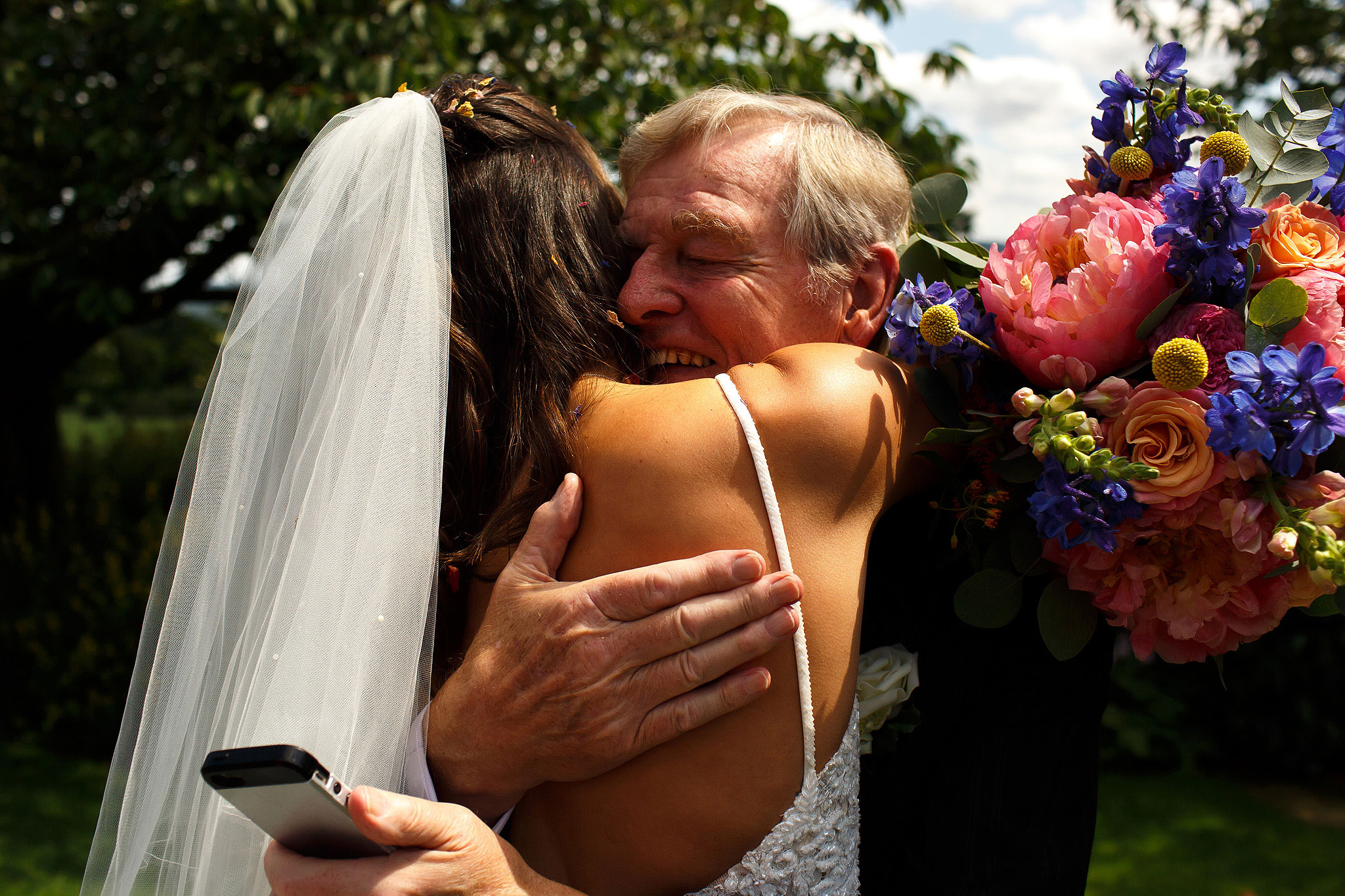 Bride hugging grandfather