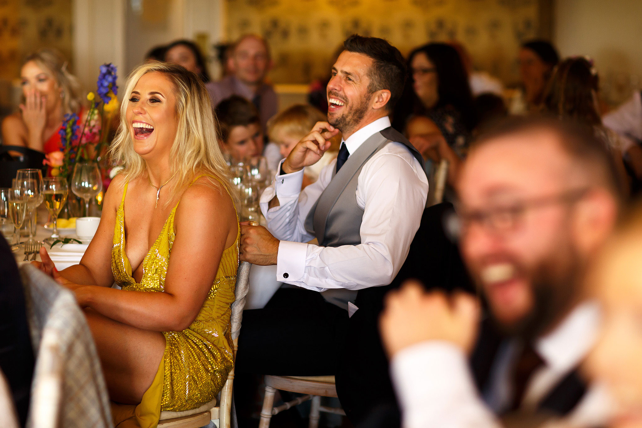 Guests laughing during speeches at Shireburn Arms