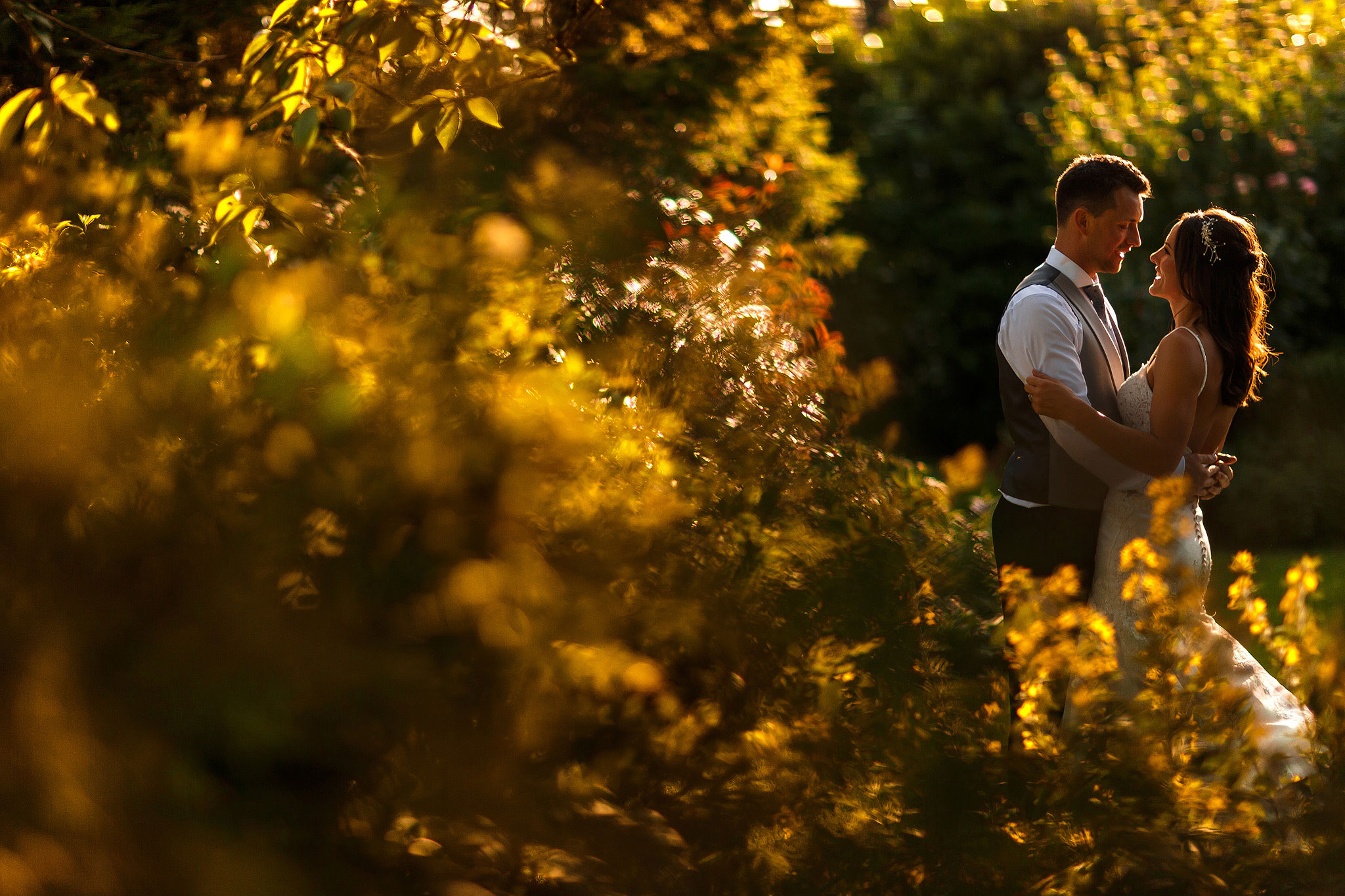 Bride and groom in golden hour in the garden at Shireburn Arms wedding