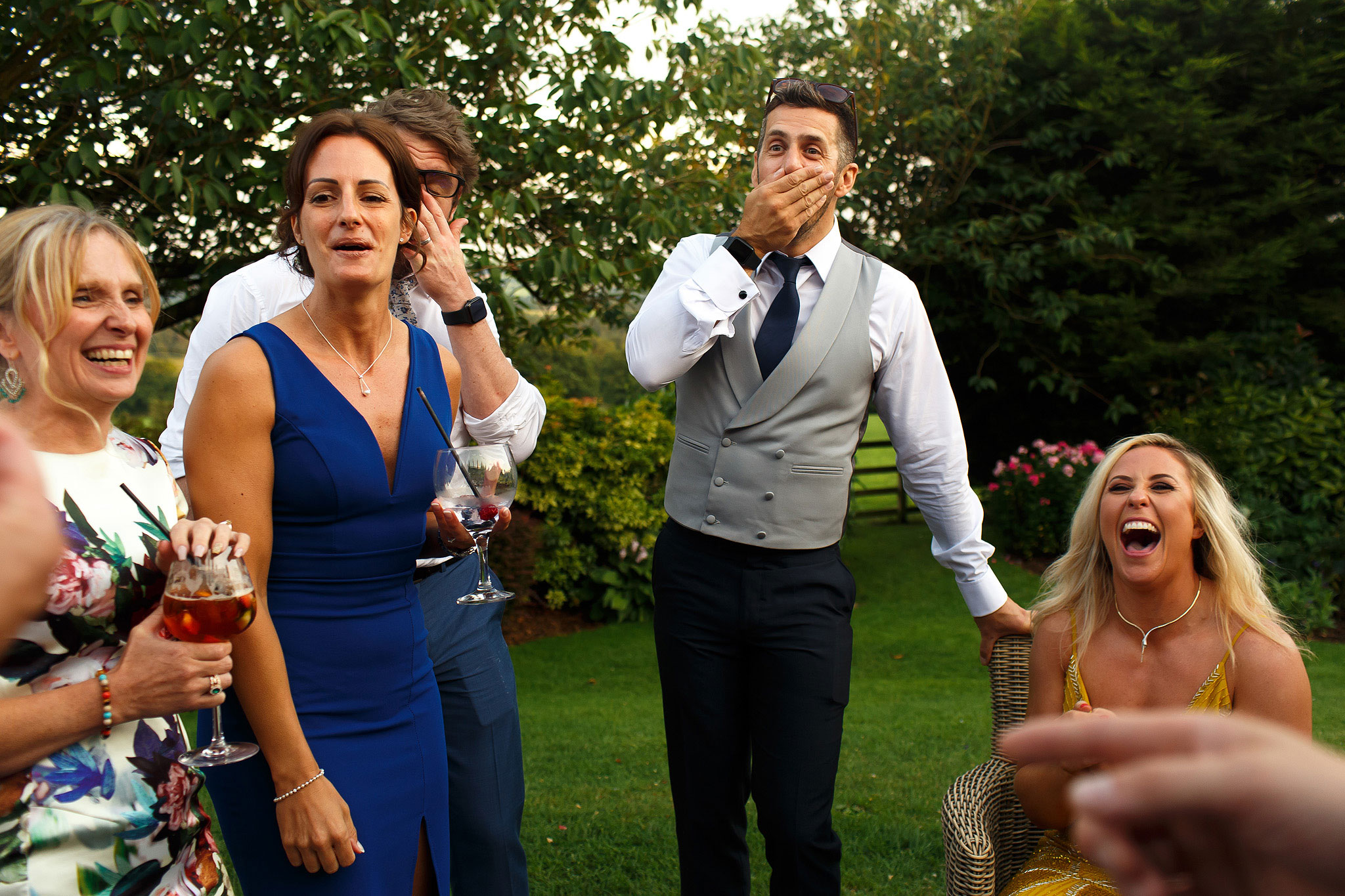 Wedding guests laughing during Shireburn Arms drinks reception