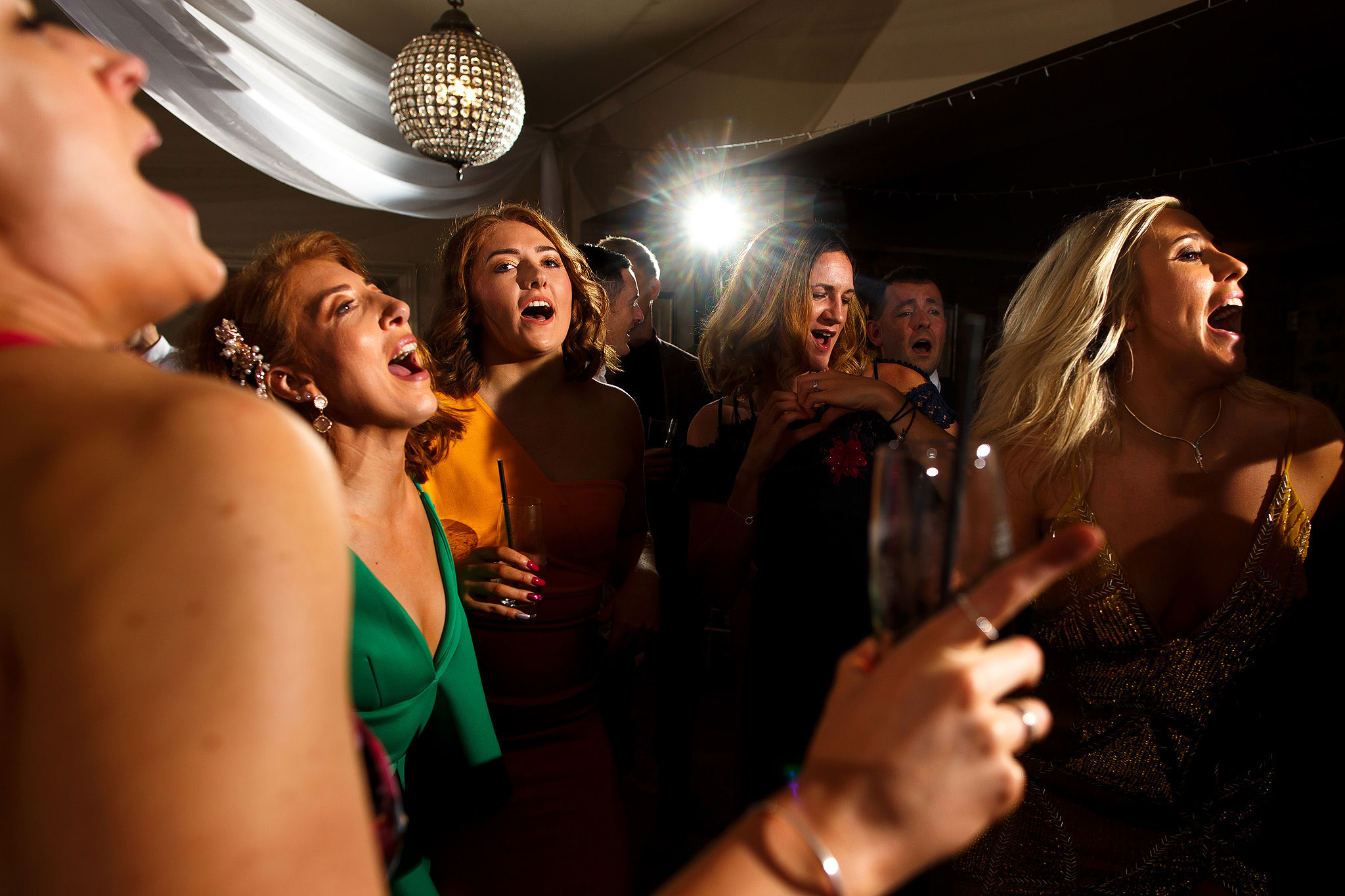 Guests on the dance floor during evening wedding reception at the Shireburn Arms
